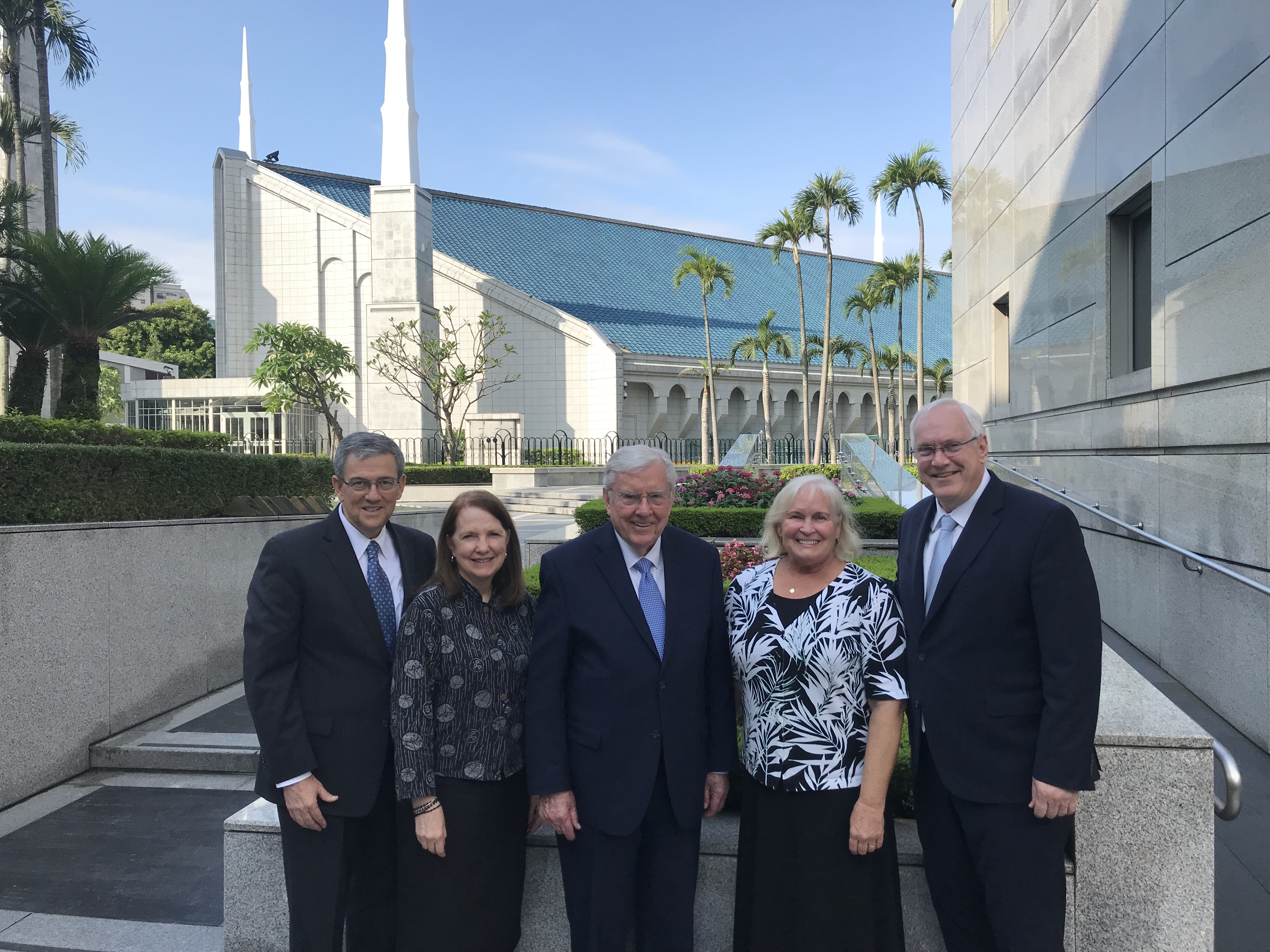 From left, Elder David F. Evans and his wife, Sister Mary Evans; President M. Russell Ballard; and Sister Lynette Gay and Elder Robert C. Gay pose outside of the temple in Taipei, Taiwan, in May 2019.