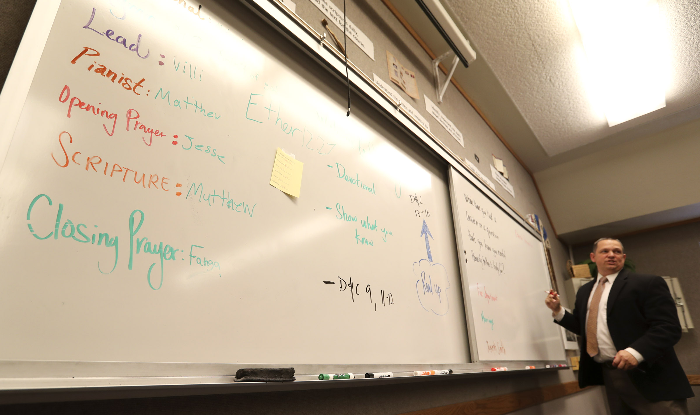 West High's Seminary principal, Trent Smith, writes on the board during an LDS seminary class at West High School in Salt Lake City on Monday, Sept. 17, 2018.