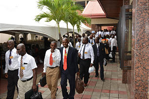 Priesthood leaders walk out of the building in Lagos, Nigeria, after a meeting.