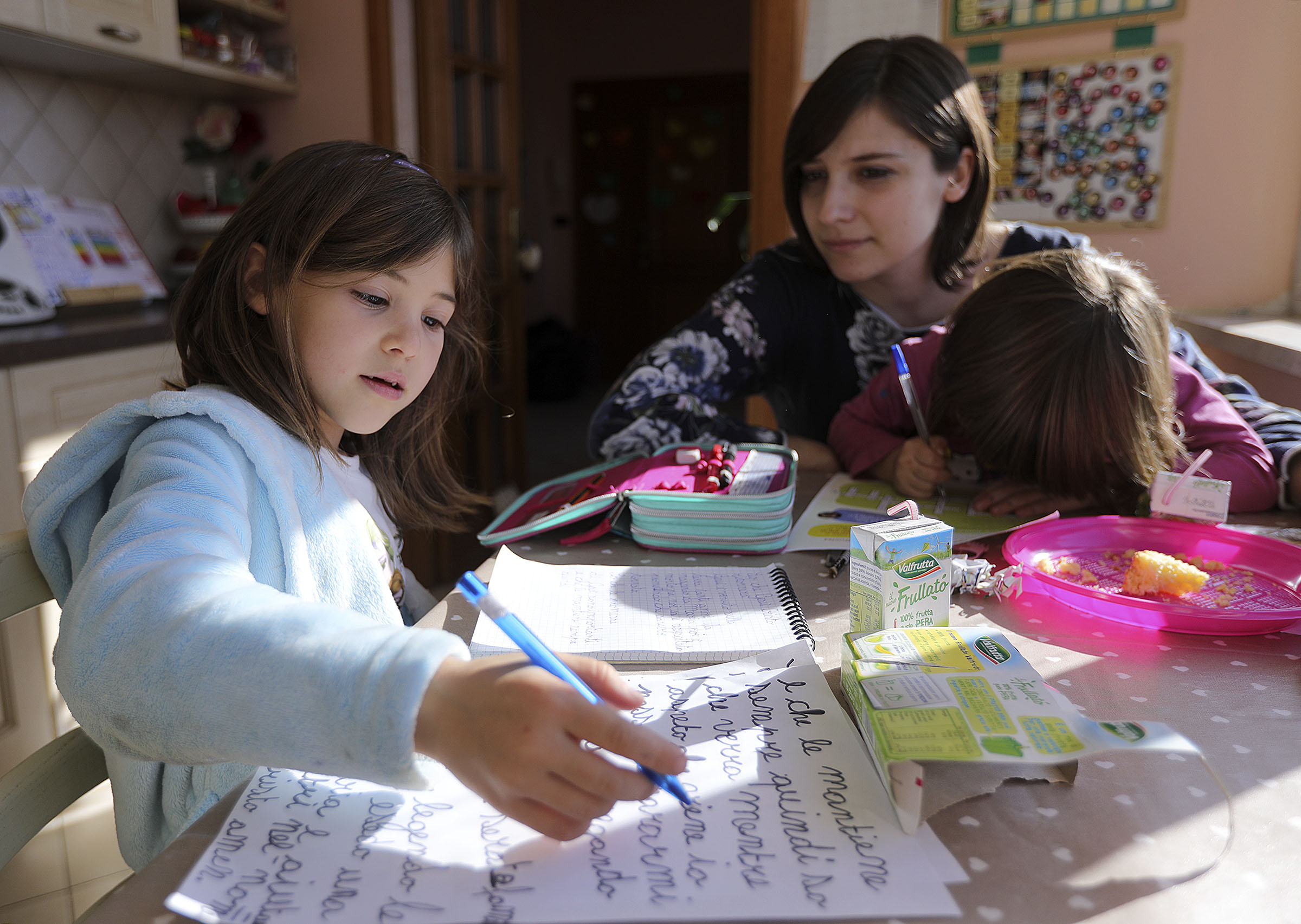 Emma Salerno, 7, prepares her Primary talk at home with her mother, Norma, and sister, Alice, in Rome, Italy, on Sunday morning, Nov. 18, 2018.