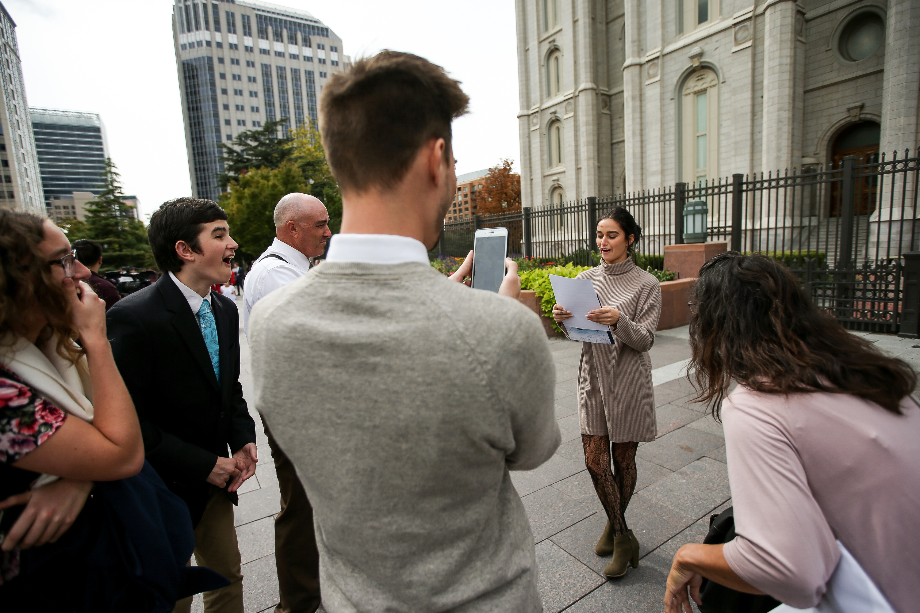 Teagan Parham, 19, of Redding, Calif., opens her mission call, which called her to serve in Chile, surrounded by family members and her boyfriend outside of Temple Square after the Saturday morning session of the 188th Semiannual General Conference of The Church of Jesus Christ of Latter-day Saints in the Conference Center in Salt Lake City on Saturday, Oct. 6, 2018.
