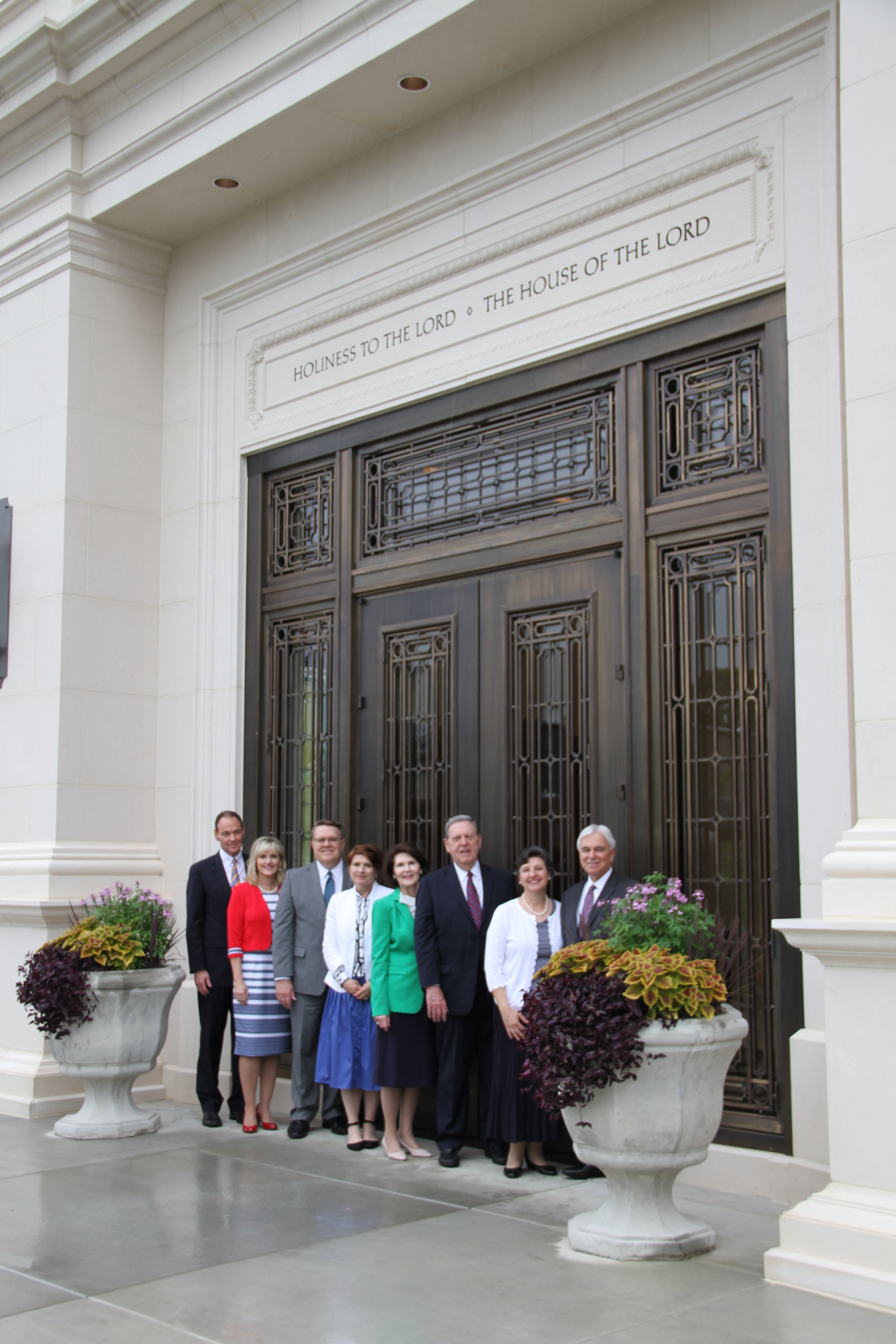 From left, Elder Michael V. Beheshti, Sister Karen Beheshti, Elder Scott D. Whiting, Sister Jeri Whiting, Sister Patricia Holland, Elder Jeffrey R. Holland, Sister Margareth Costa and Elder Claudio R. M. Costa pose for photos outside the Memphis Tennessee Temple after touring the recently renovated temple on May 4, 2019.