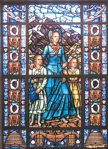 Colorful stained glass window in museum was designed to honor pioneer mothers. The window was taken from a sketch by Utah artist Avard Fairbanks and built by The Church Art Glass Studio of San Francisco.