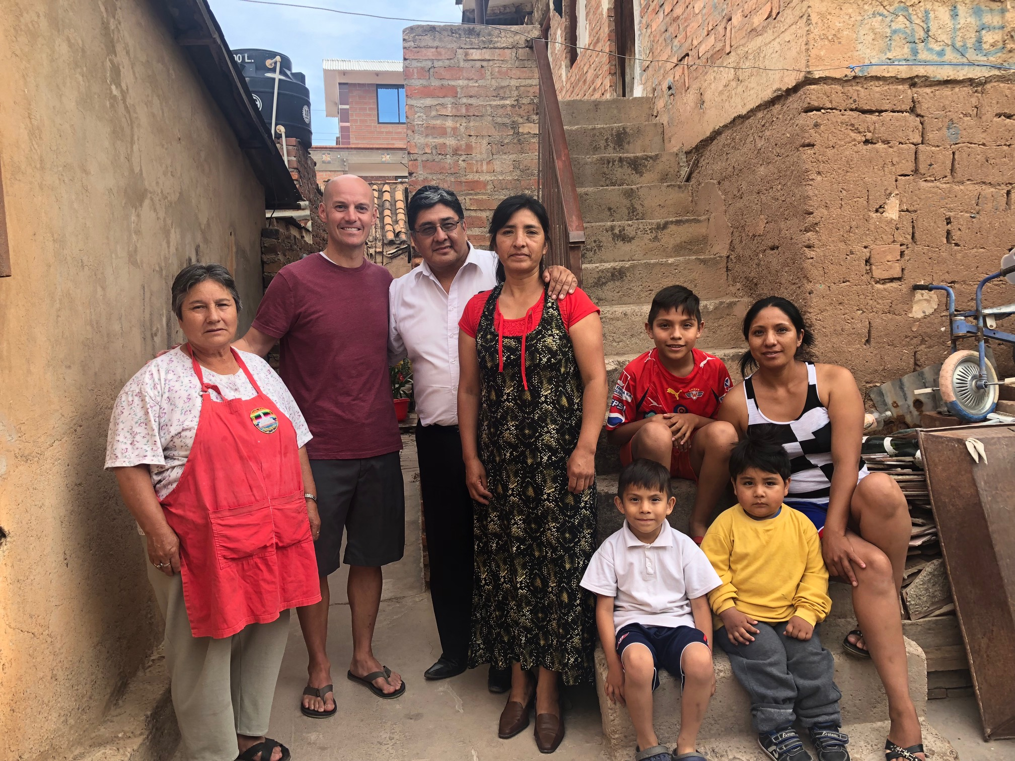 Scott Mortensen with the Quintanilla family in the Sipe Sipe area which he visited when he returned to visit Bolivia in October. He spent many days eating lunch with the Quintanilla family while serving in the are some 20 years ago.