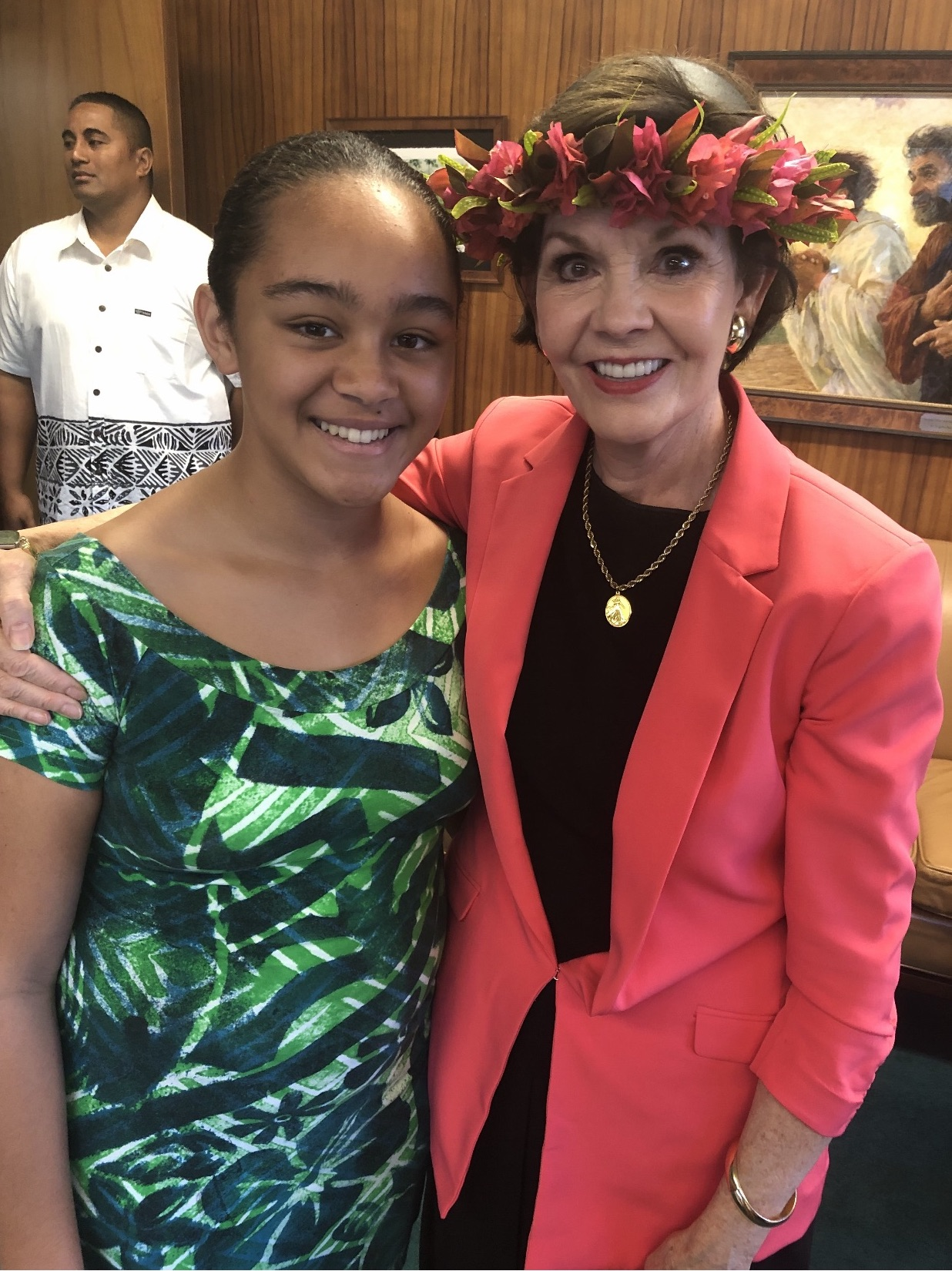 "Sister Kristen Oaks, right, a great-granddaughter of President Joseph F. Smith, is joined by Tanaya Ale, a great-great-great-granddaughter of Ma Mahuhii, a Hawaiian woman who nursed President Smith back to health when he fell seriously ill in Hawaii as a 15-year-old starting what would be a four-year mission there. Orphaned following the 1844 martyrdom death of his father, Hyrum Smith, and the passing of his mother, Mary Fielding Smith, two years before his mission, the young Joseph F. Smith considered Mahuhii his ""second mother"" for her loving care. Bishop Charles W. Nibley recounted witnessing a tender reunion years later in accompanying President Smith on a visit to the islands: ""I noticed a poor, old, blind woman tottering under the weight of about 90 years being led \[into the meeting house where the Saints were gathering to greet President Joseph F. Smith\]. She had a few choice bananas in her hand. It was her all–her offering. She was calling 'Iosepa, Iosepa!' Instantly, when he saw her, he ran to her and clasped her in his arms, hugged her, and kissed her over and over again, patting her on the head saying, 'Momma, Momma, my dear old Momma!' And with tears streaming down his cheeks he turned to me and said, 'Charley, she nursed me when I was a boy, sick and without anyone to care for me. She took me in and was a mother to me!' "" \[From ""The Life of Joseph F. Smith,"" Joseph Fielding Smith, p. 185-86\]"