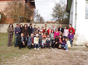 Municipal leaders, community members, teachers and some of the children of the Zahir school in Turiqca, Kosovo, gather to celebrate the improvements and supplies for their school.