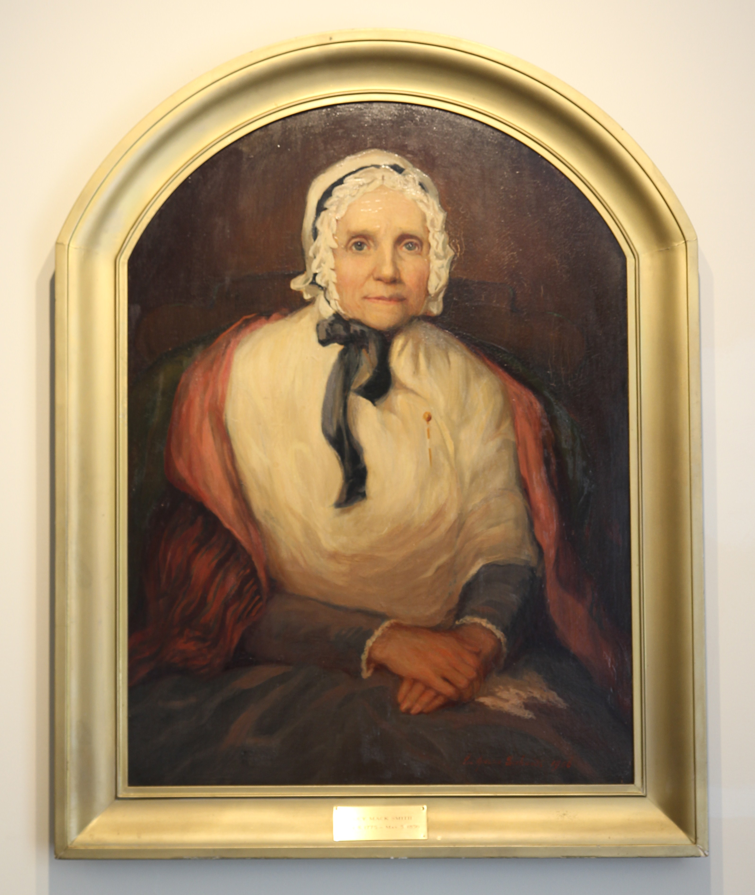 A painting of Lucy Mack Smith hangs in the Joseph Smith Birthplace Memorial.