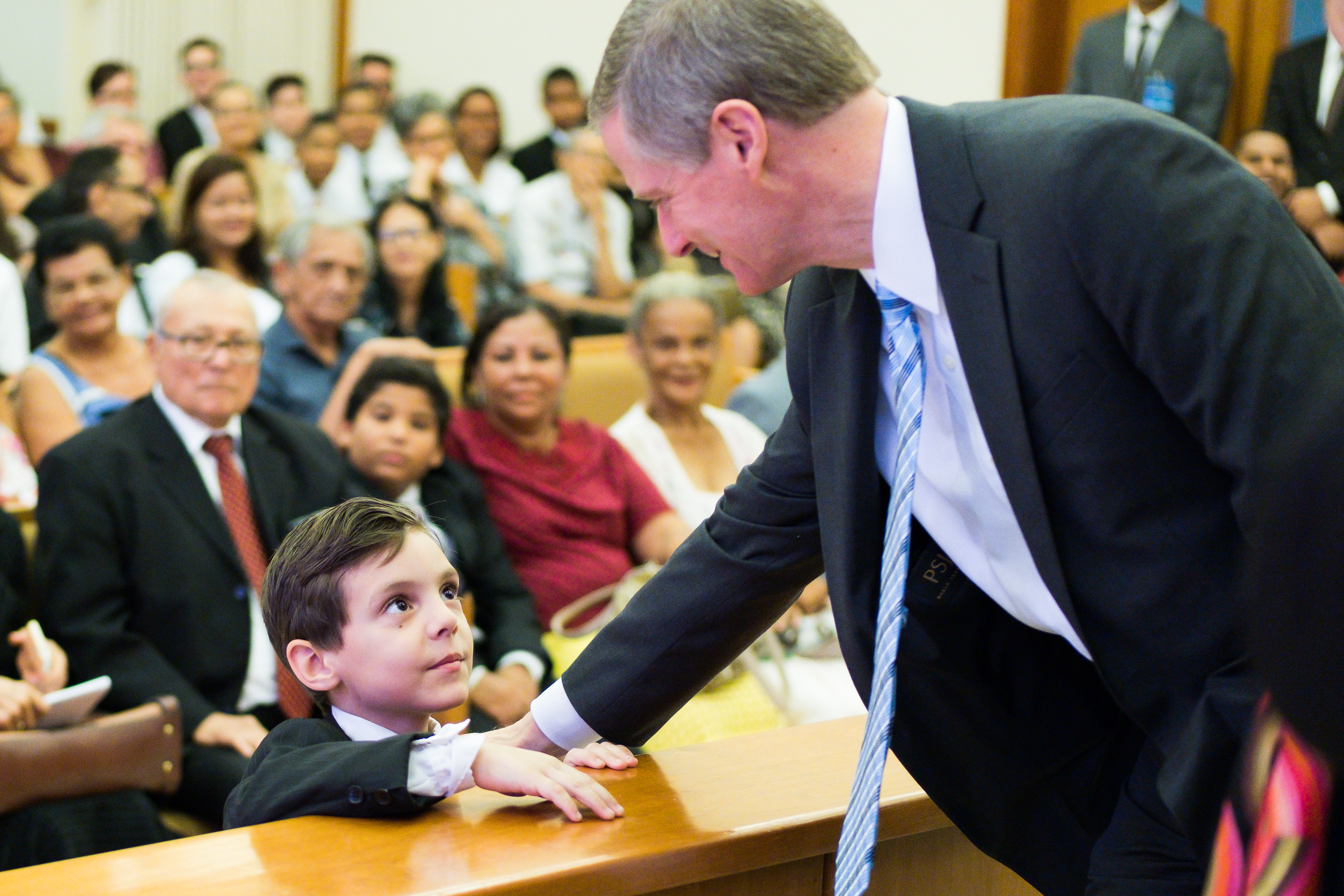 """Elder Bednar greets a child and tells him to """"be a good boy"""" after a stake meeting in Recife, Brazil."""