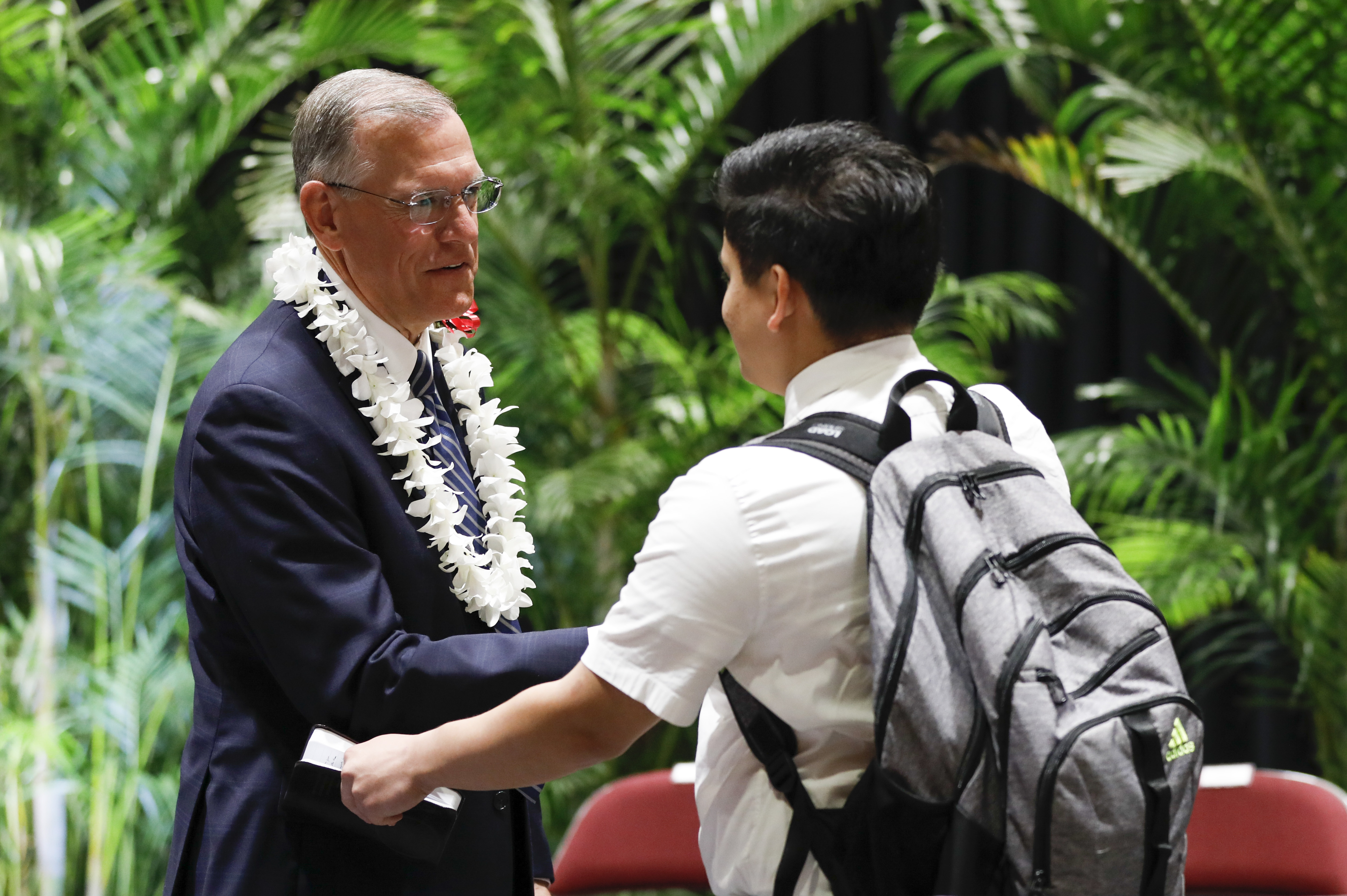 Elder Steven R. Bangerter greets students following a BYU-Hawaii devotional on March 19, 2019.