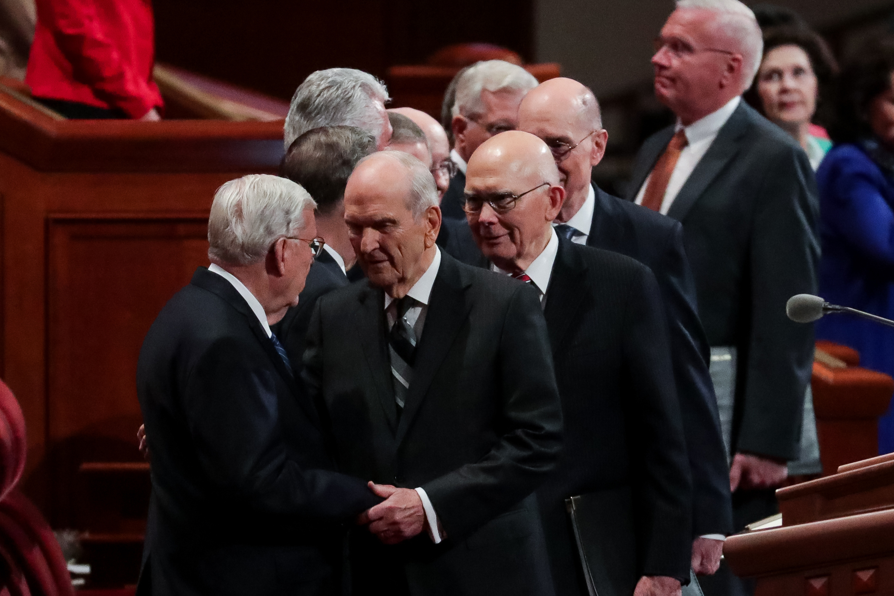 President Russell M. Nelson, center, embraces President M. Russell Ballard, acting president of the Quorum of the Twelve Apostles, left, at the start of the Saturday morning session of the 188th Semiannual General Conference of The Church of Jesus Christ of Latter-day Saints in the Conference Center in Salt Lake City on Saturday, Oct. 6, 2018.