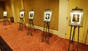 Photos of former Distinguished Utahn award recipients lined the walls of a banquet room during this year's event.
