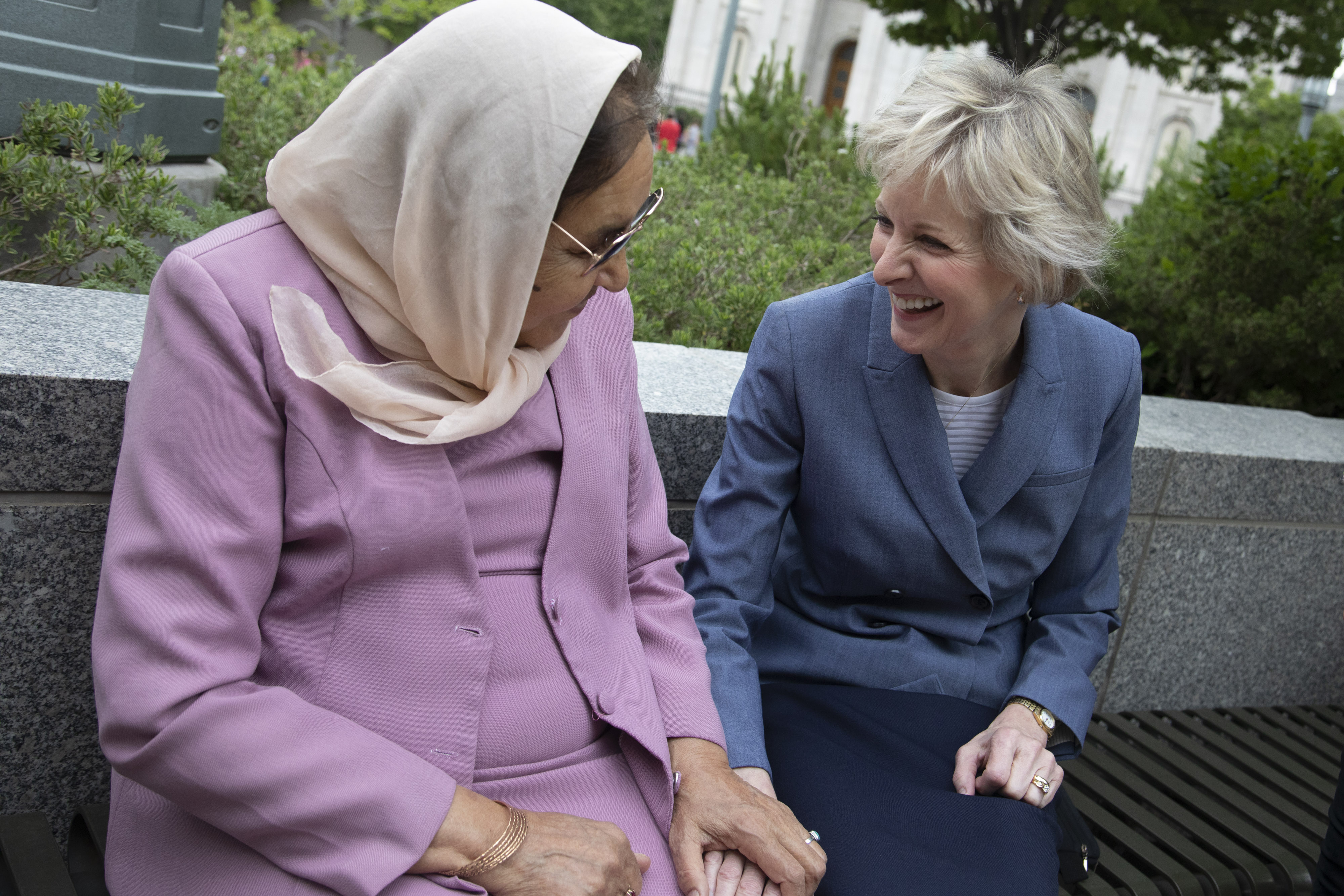 Sister Jean B. Bingham and her friend Asifa Nadir sit outside the Relief Society Building on Temple Square prior to an interview with representatives from USA for UNHCR on May 16, 2019. Sister Bingham has known the Nadir family, refugees from Afghanistan for nearly 15 years.
