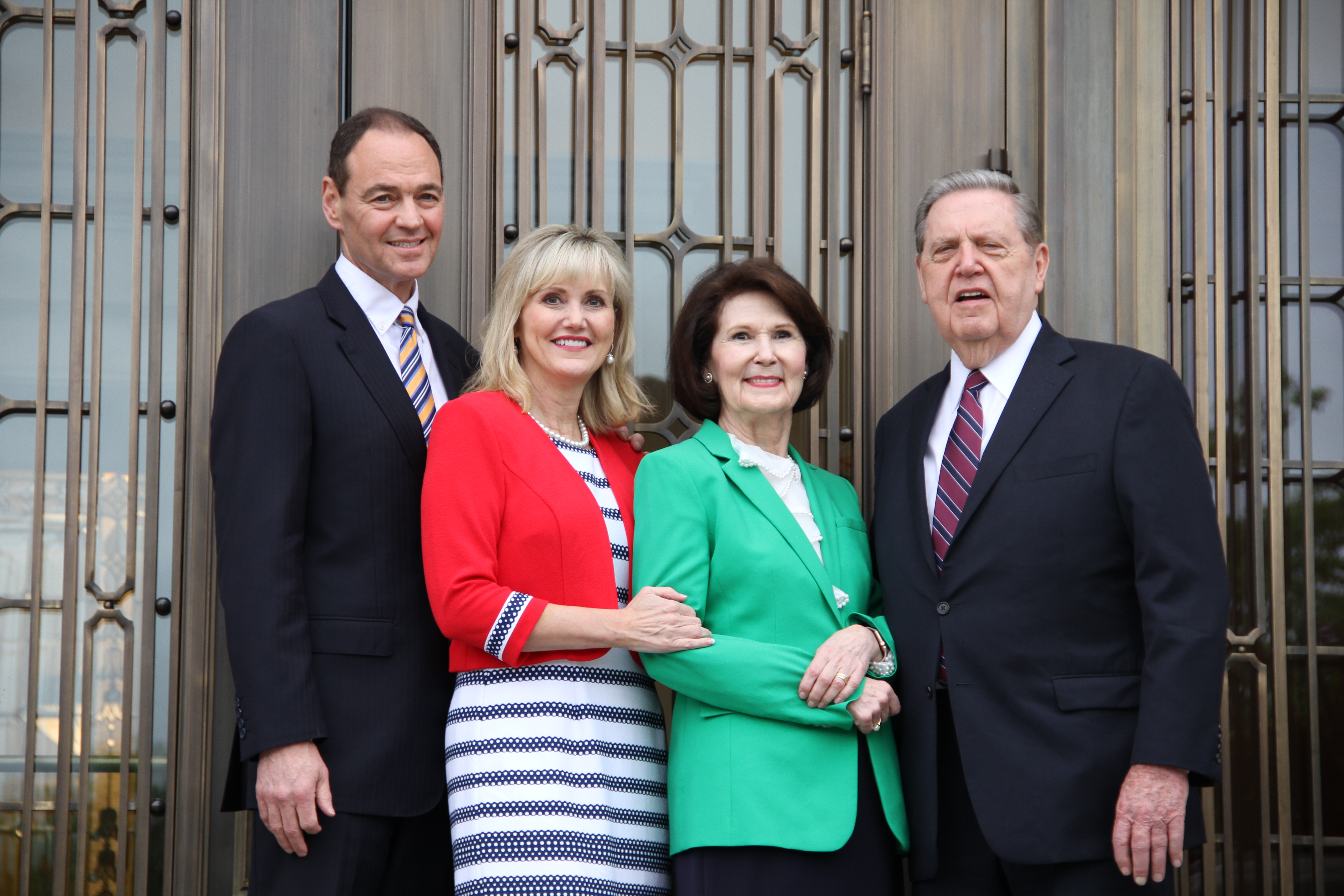 Elder and Sister Beheshti pose with Elder and Sister Holland in front of the entrance of the Memphis Tennessee Temple on May 4, 2019.