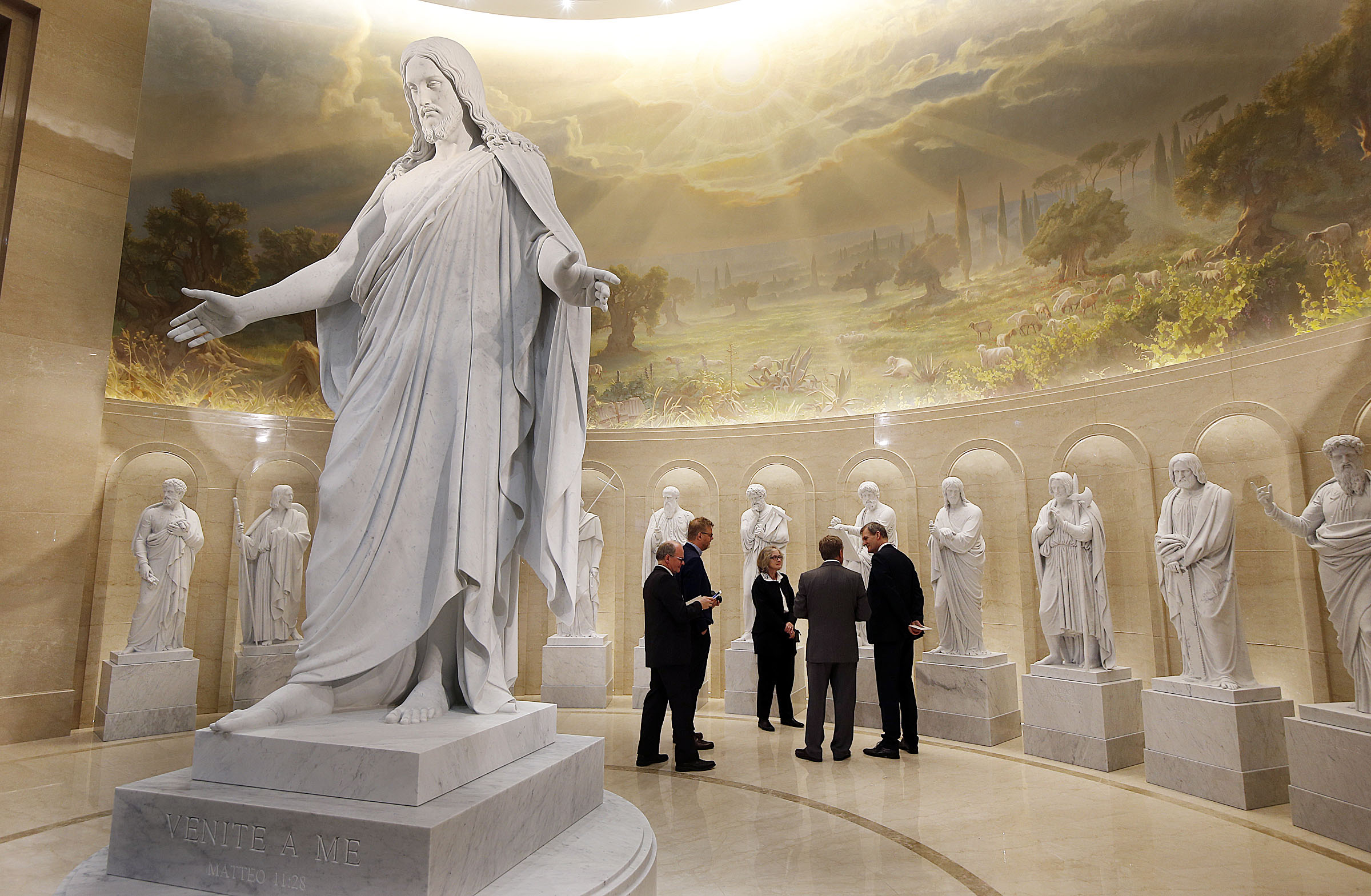 A delegation from Copenhagen's Church of Our Lady, home of the original Thorvaldsen statues of the Christus and ancient 12 apostles visit the Rome Temple Visitors's Center to see the digital, 3-D, marble replicas and talk with the temple's architect in Rome, Italy on Wednesday, Jan. 16, 2019.
