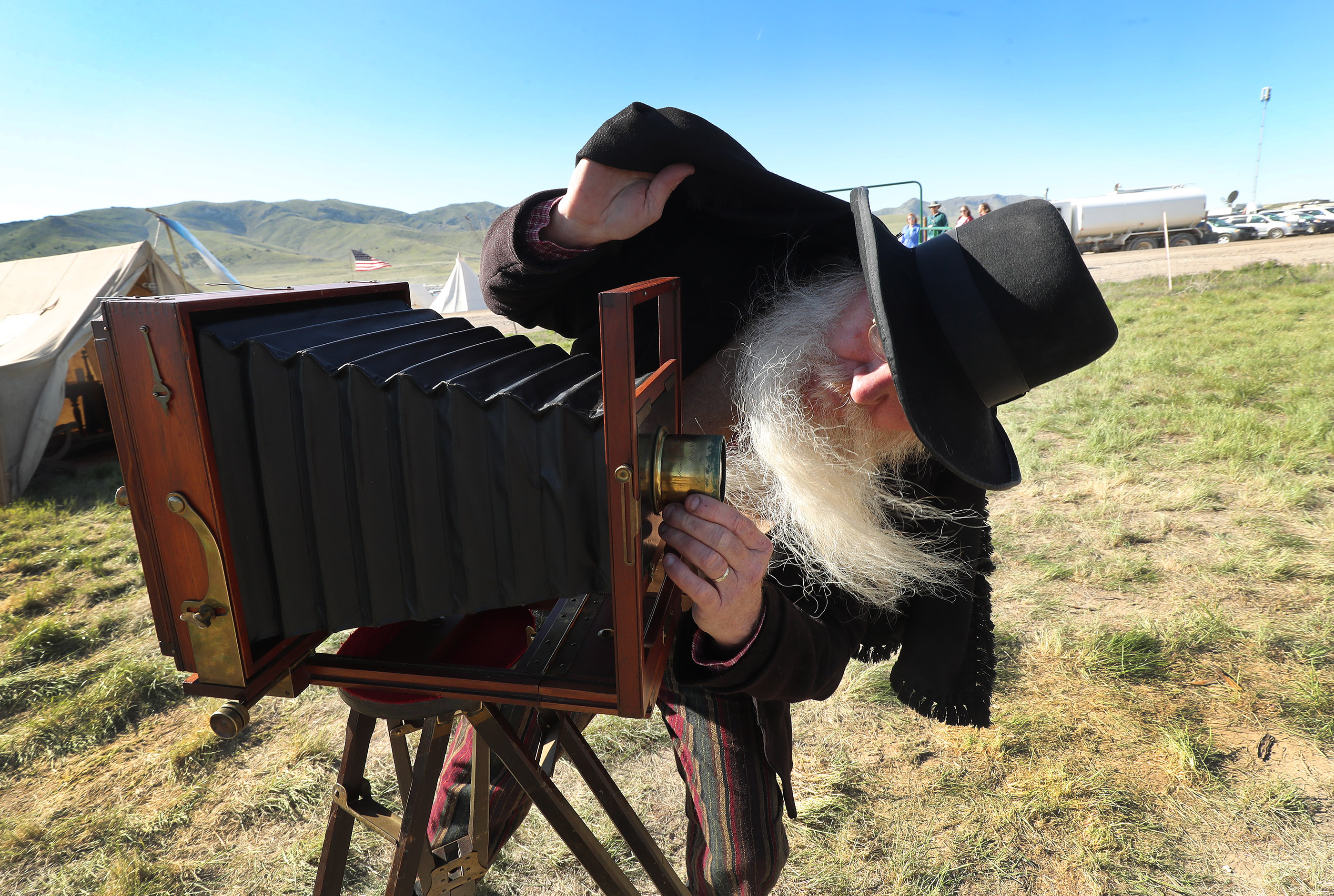 Vintage photographer Mark Brown takes a photo during the 150th anniversary celebration at the Golden Spike National Historical Park at Promontory Summit on Friday, May 10, 2019.