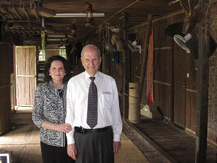 Elder Russell M. Nelson and his wife, Sister Wendy Nelson, visit a longhouse in East Malaysia on the island of Borneo.