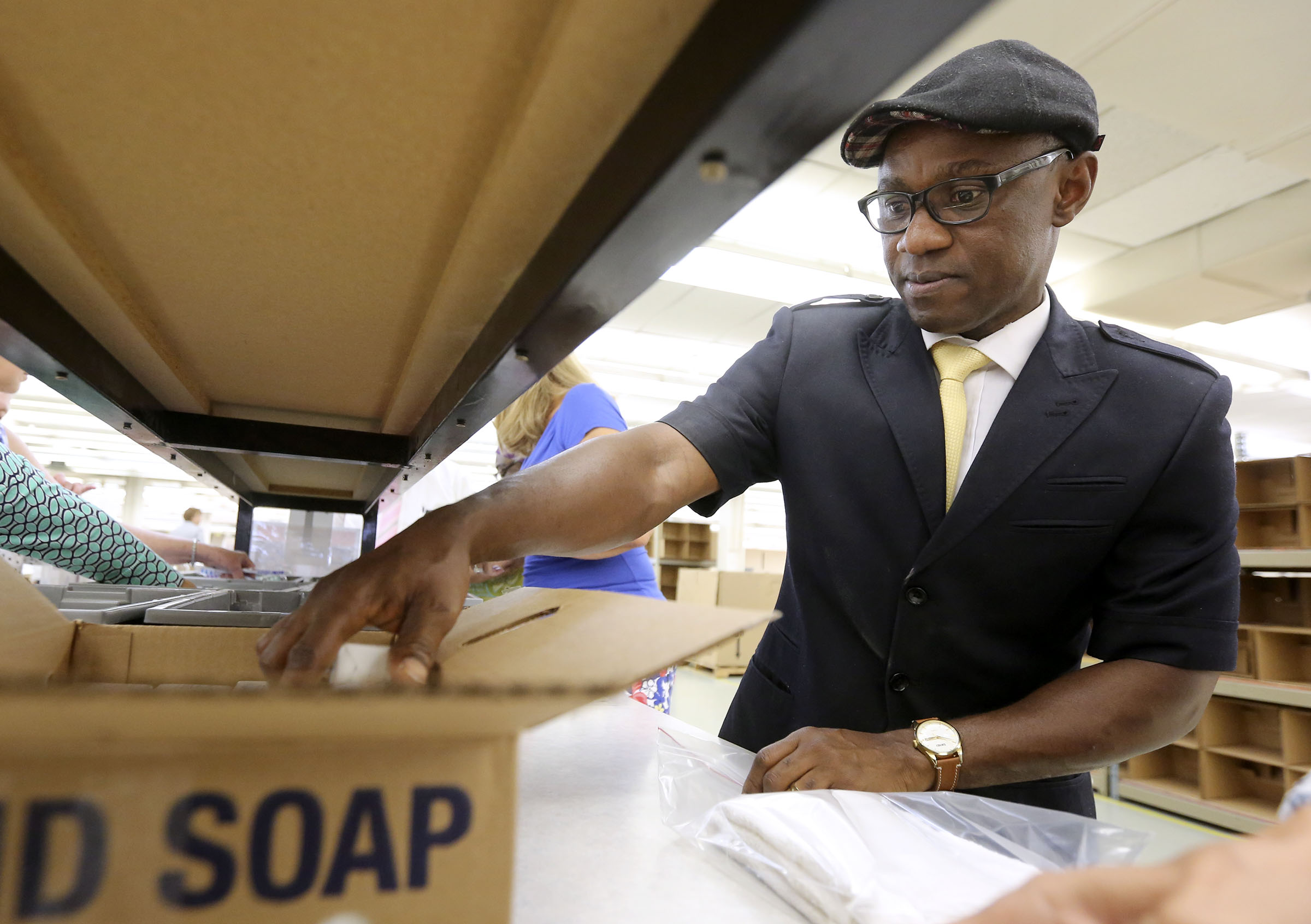 Bayo Olayemi helps make sanitary kits at the Latter-day Saint Humanitarian Center in Salt Lake City on Thursday, July 25, 2019.