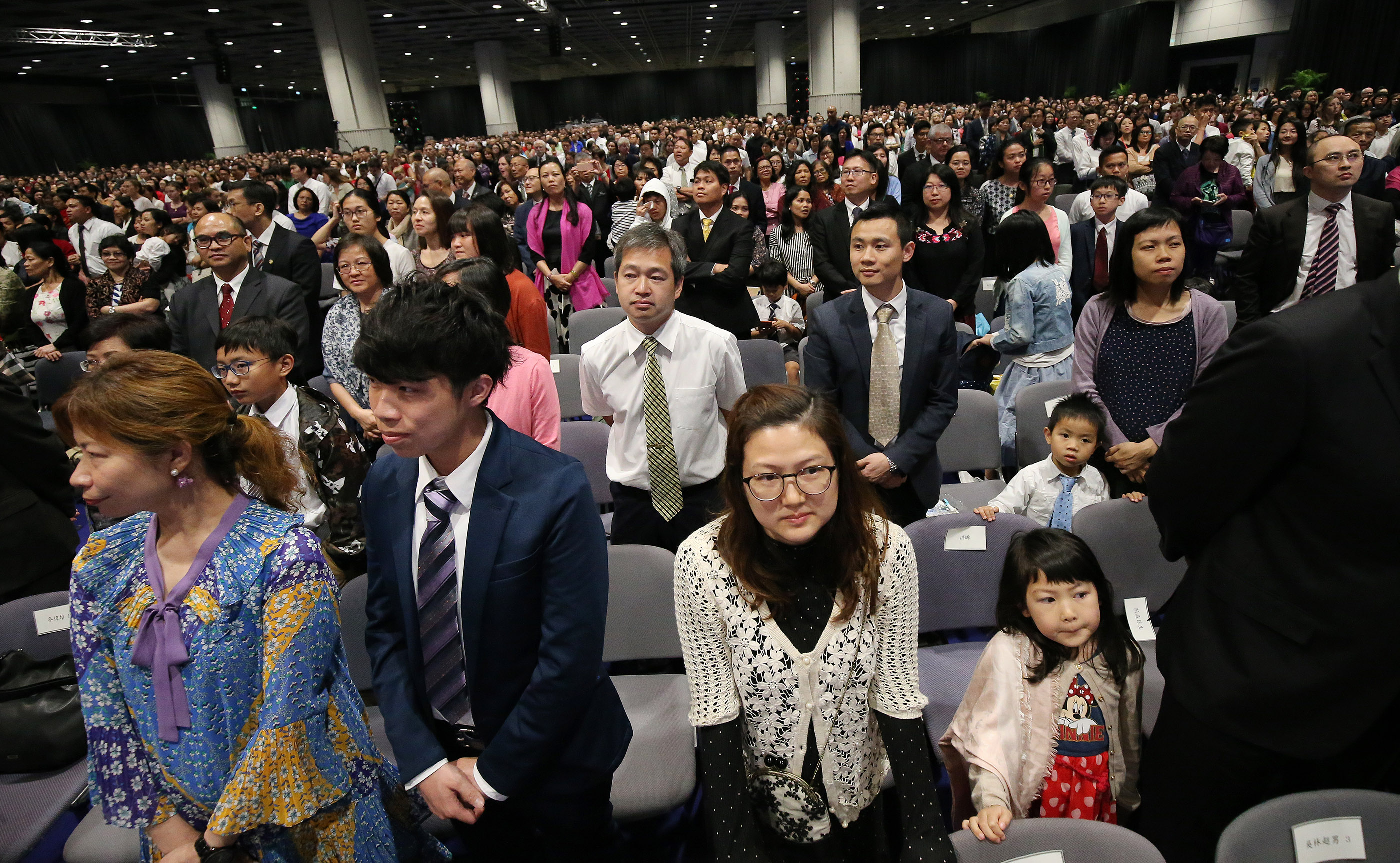 Attendees watch as President Russell M. Nelson leaves the stand after a devotional in Hong Kong on Saturday, April 21, 2018.
