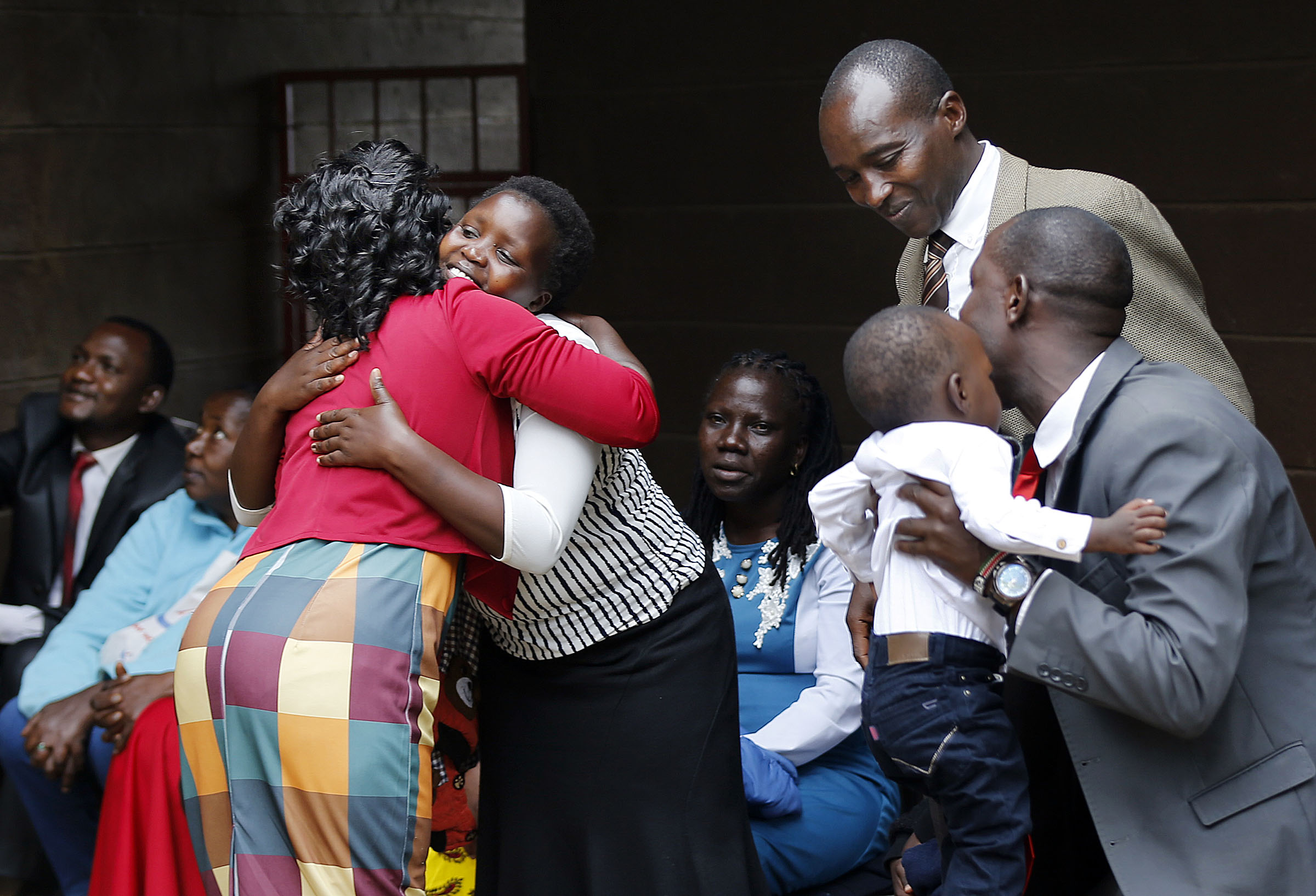People greet before a special devotional with President Russell M. Nelson of The Church of Jesus Christ of Latter-day Saints in Nairobi, Kenya, on Monday, April 16, 2018. At left, Elizabeth Naku hugs Corredy Kuria.
