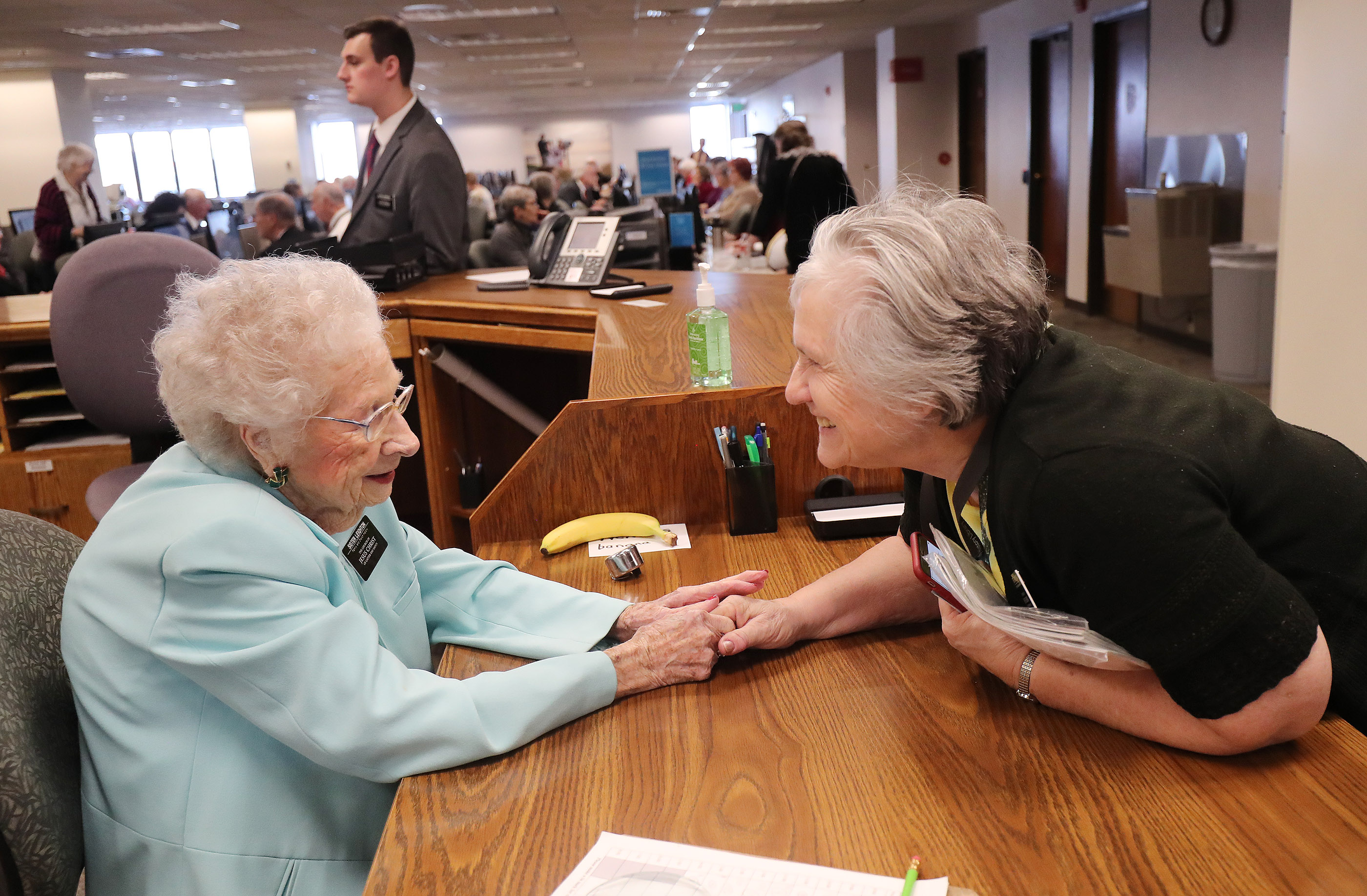 Nellie Leighton, 99, left, talks with fellow missionary Carolyn Woodman at the Family History Library in Salt Lake City on Tuesday, Jan. 22, 2019. Leighton will celebrate her 100th birthday in February.