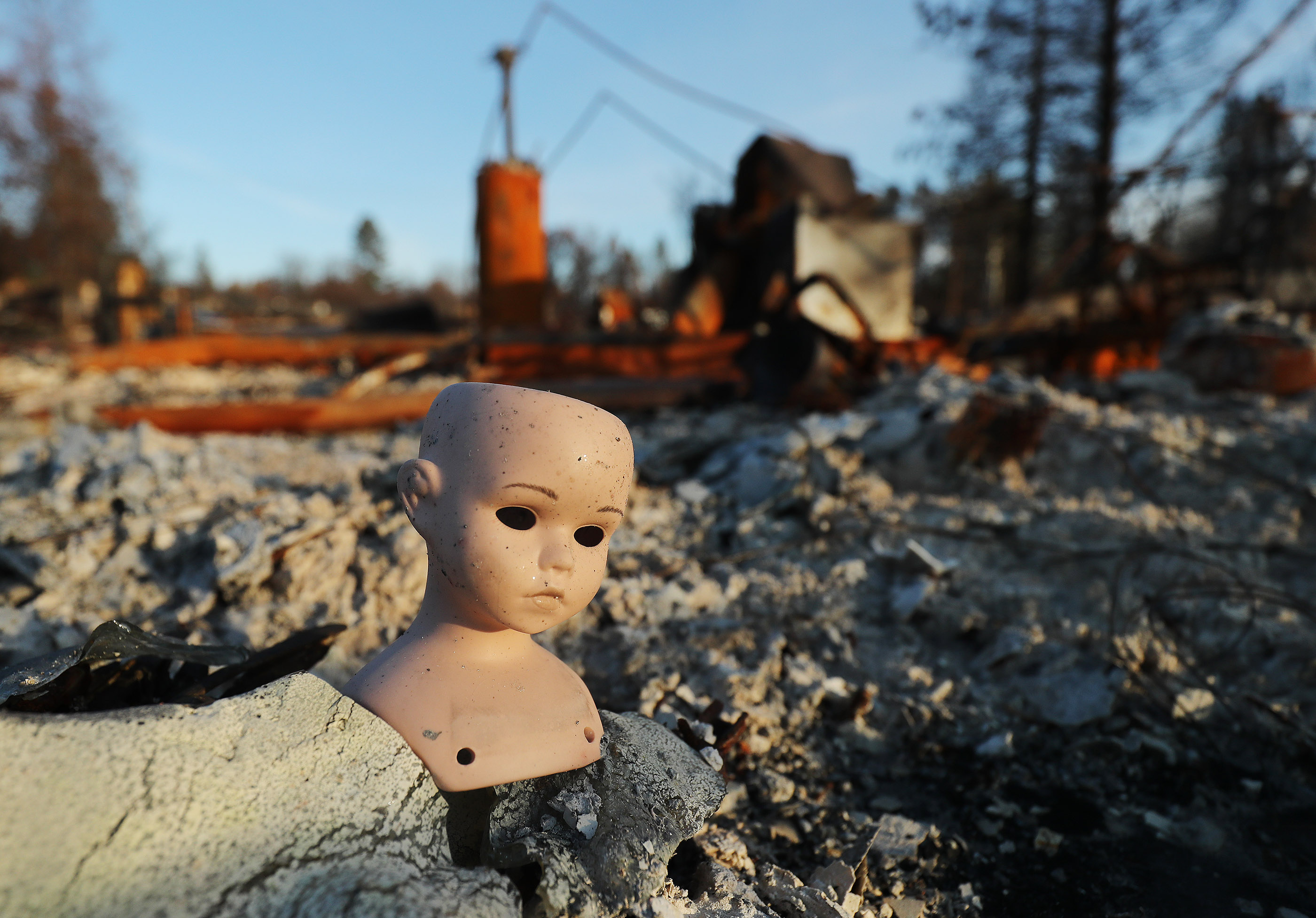 A doll remains in the destruction in Paradise, California, on Saturday, Jan. 12, 2019, two months after the Camp Fire destroyed more than 18,000 homes and businesses.