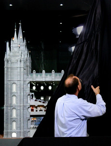 Lee Alger, staging specialist for the Conference Center, unveils a special temple exhibit in the South Visitors Center on Temple Square on May 28, 2010.