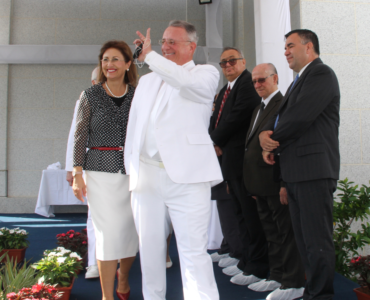 Elder Ulisses Soares of the Quorum of the Twelve Apostles, with his wife, Sister Rosasa Soares, waves to members after the cornerstone ceremony portion of the dedication session of the Fortaleza Brazil Temple on Sunday, June 2, 2019.