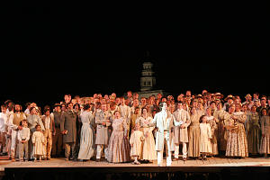 "Dallin Bayles, portraying the Prophet Joseph Smith, stands in foreground before the cast of the new pageant in Nauvoo, which continues through Aug. 8 with nightly performances. A core cast performs throughout the run, augmented by four ""family casts"" of about 150 vounteers. Each family cast will spend 14-17 days of the monthlong run appearing in the pageant."