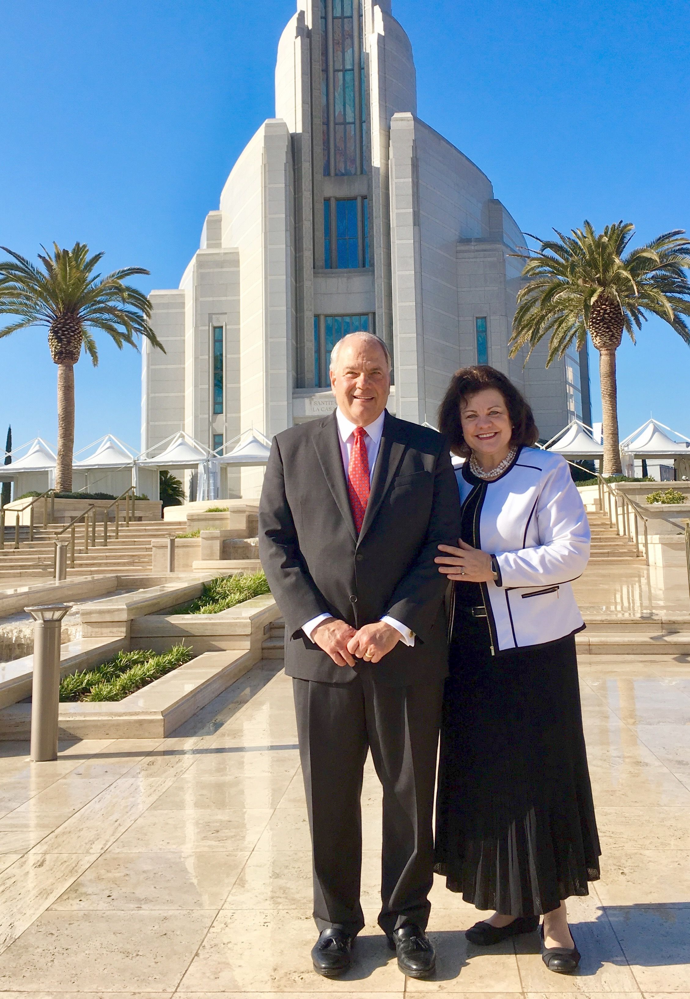 Elder Ronald A. Rasband and his wife, Sister Melanie Rasband, stand in front of the Rome Italy Temple.
