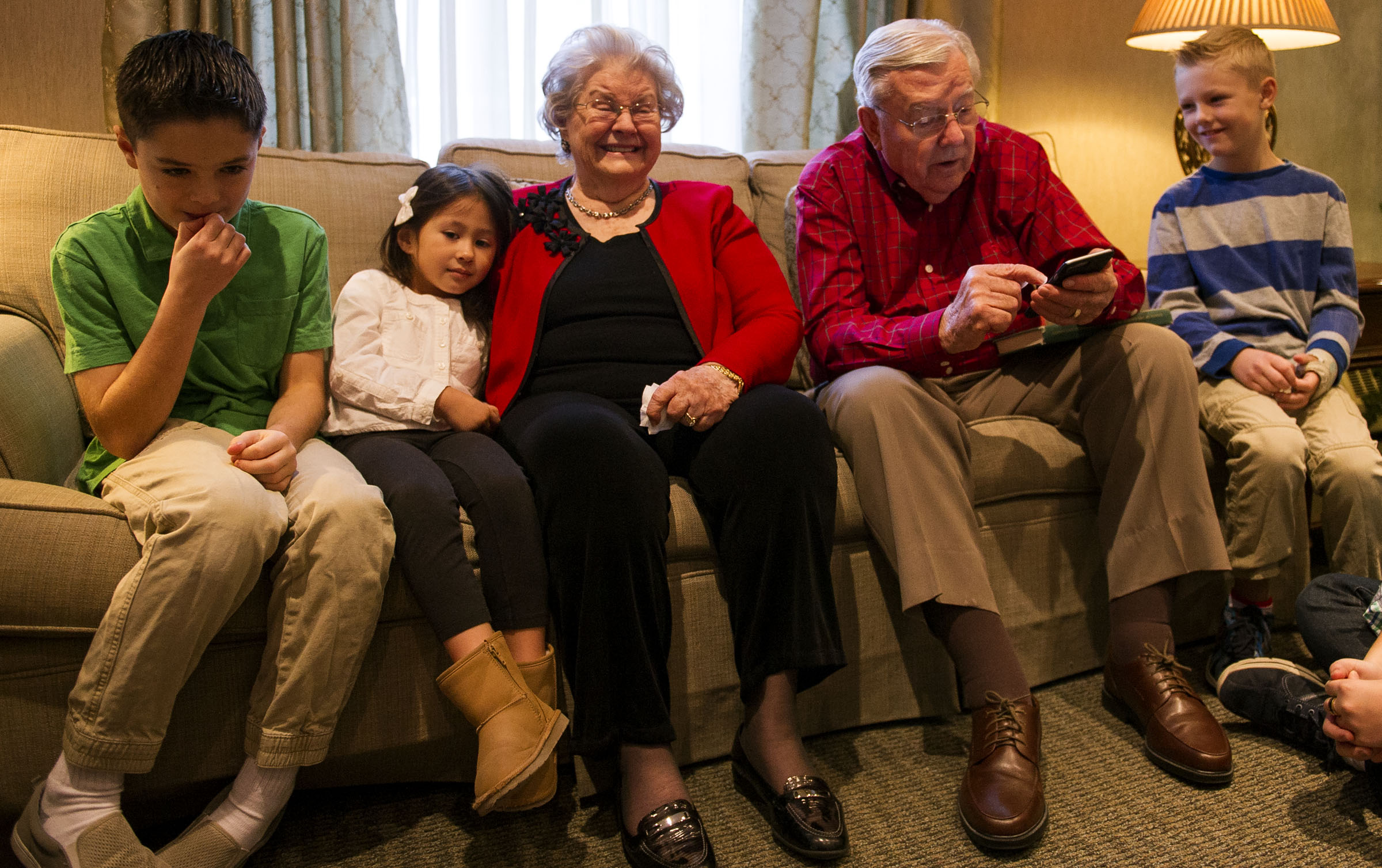Sister Barbara B. Ballard, center, laughs while her husband, Elder M. Russell Ballard, reads a missionary's report to family members during a family council meeting in Salt Lake City on Monday, Dec. 26, 2016.