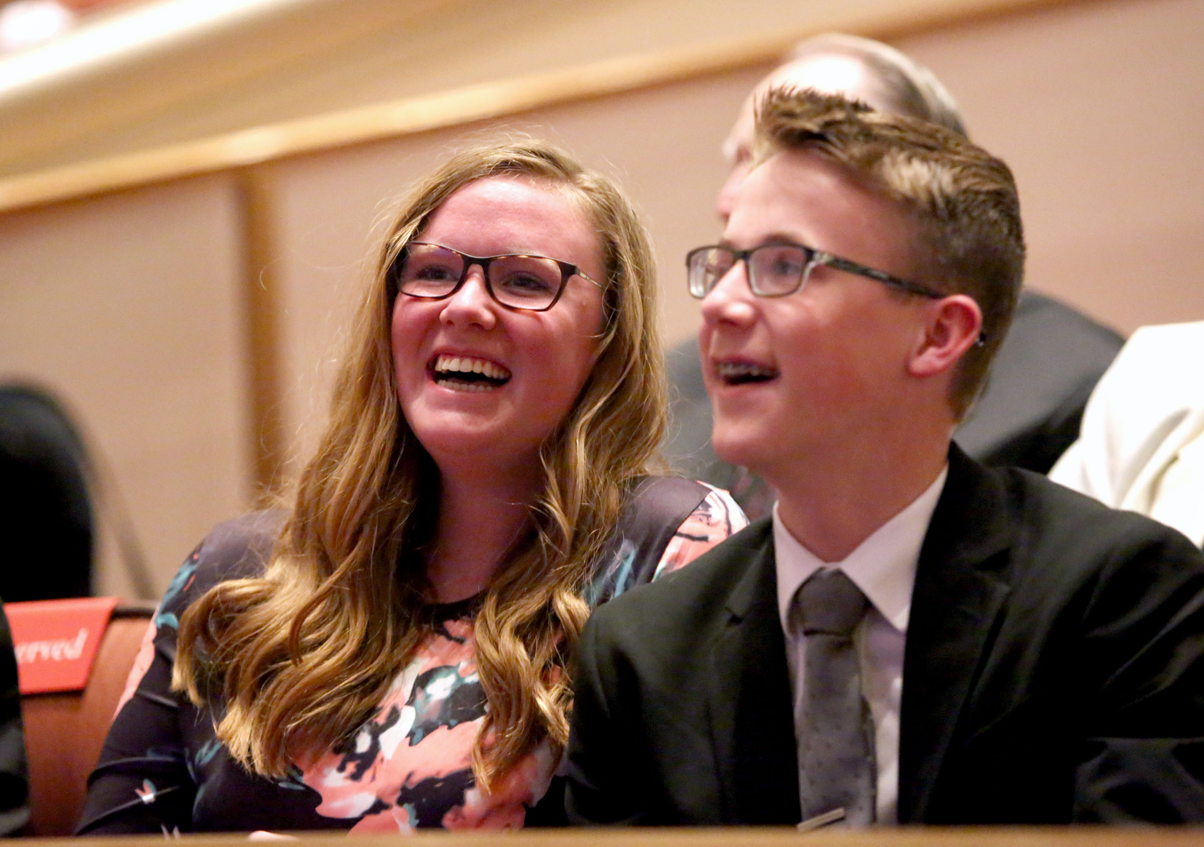 Conferencegoers react to LDS Church President Russell M. Nelson's announcement that there will be seven new temples around the world, including one in Layton, Utah, during the Sunday afternoon session of the 188th Annual General Conference of The Church of Jesus Christ of Latter-day Saints at the Conference Center in Salt Lake City on Sunday, April 1, 2018.
