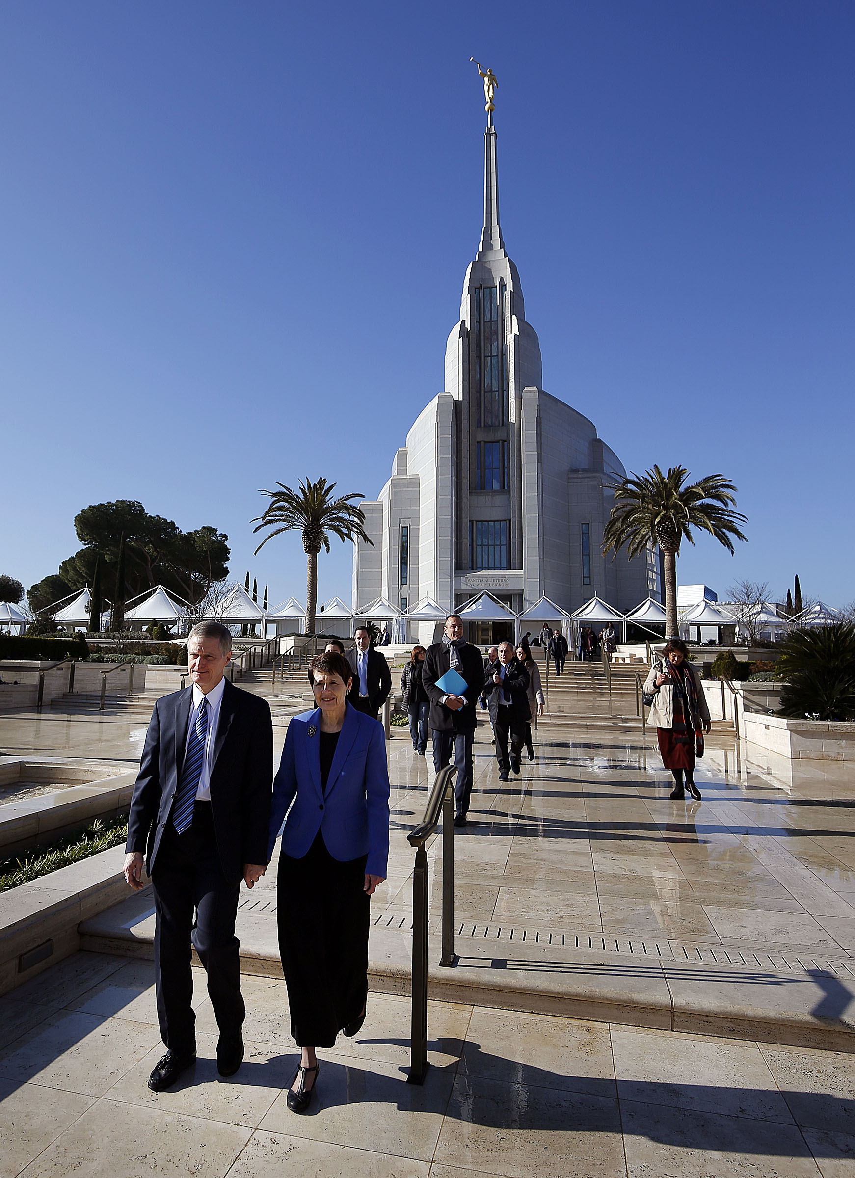 Elder David A. Bednar of the Quorum of the Twelve Apostles and his wife Susan walk from the Rome Italy Temple to the Rome Temple Visitor's Center of The Church of Jesus Christ of Latter-day Saints on Monday, Jan. 14, 2019. Rome City officials and other dignitaries follow behind.