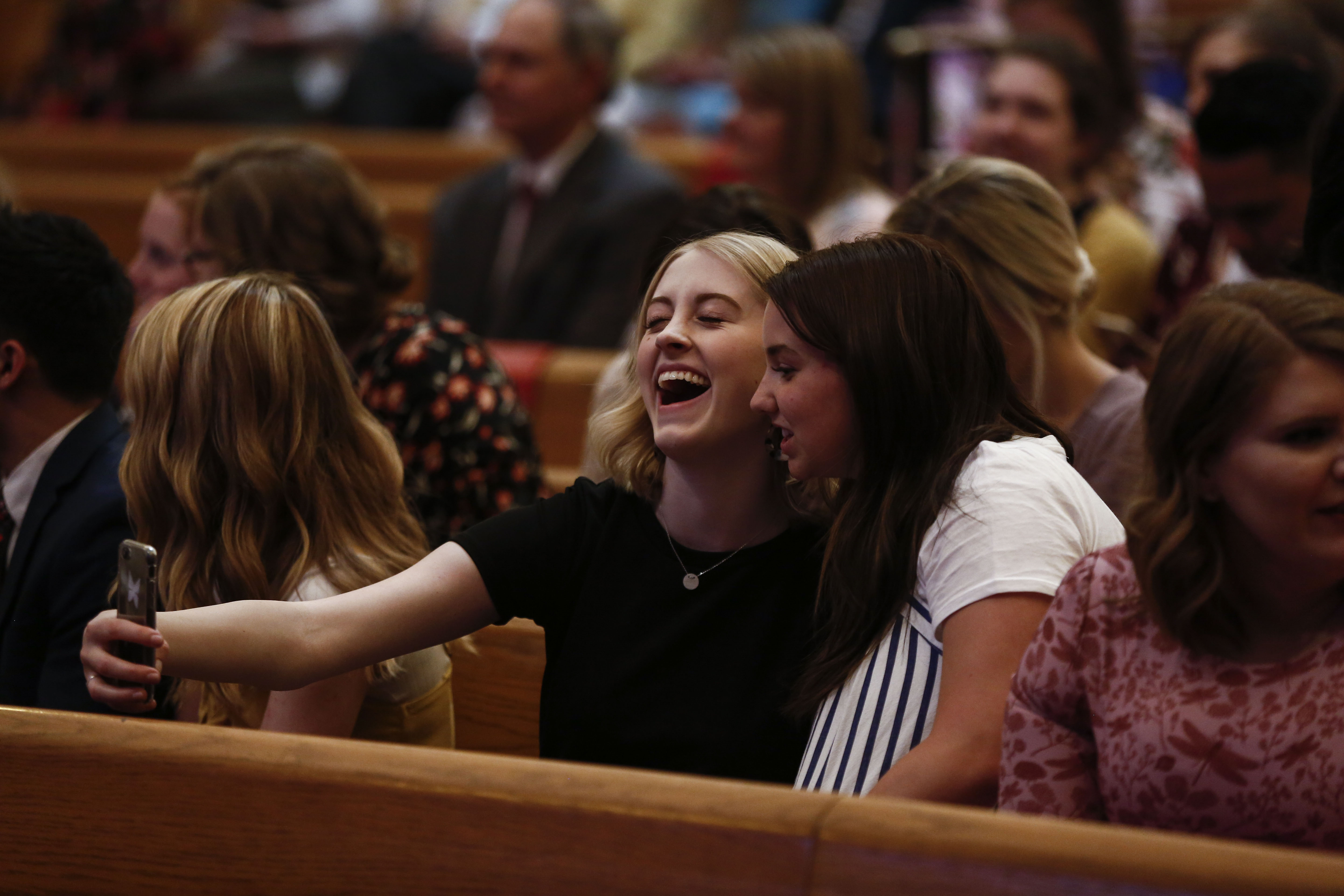 Isabelle Purdie and Maddie Barkdull take a selfie before the Worldwide Devotional for Young Adults at the Salt Lake Tabernacle in Salt Lake City on Sunday, May 5, 2019.