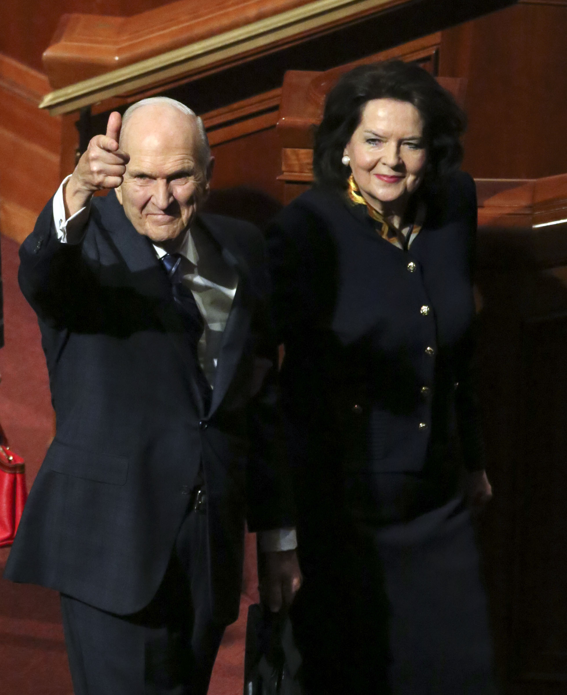 President Russell M. Nelson points to the crowd as he and his wife, Sister Wendy Nelson, leave the Sunday morning session of the 188th Semiannual General Conference of The Church of Jesus Christ of Latter-day Saints in the Conference Center in downtown Salt Lake City on Sunday, Oct. 7, 2018.