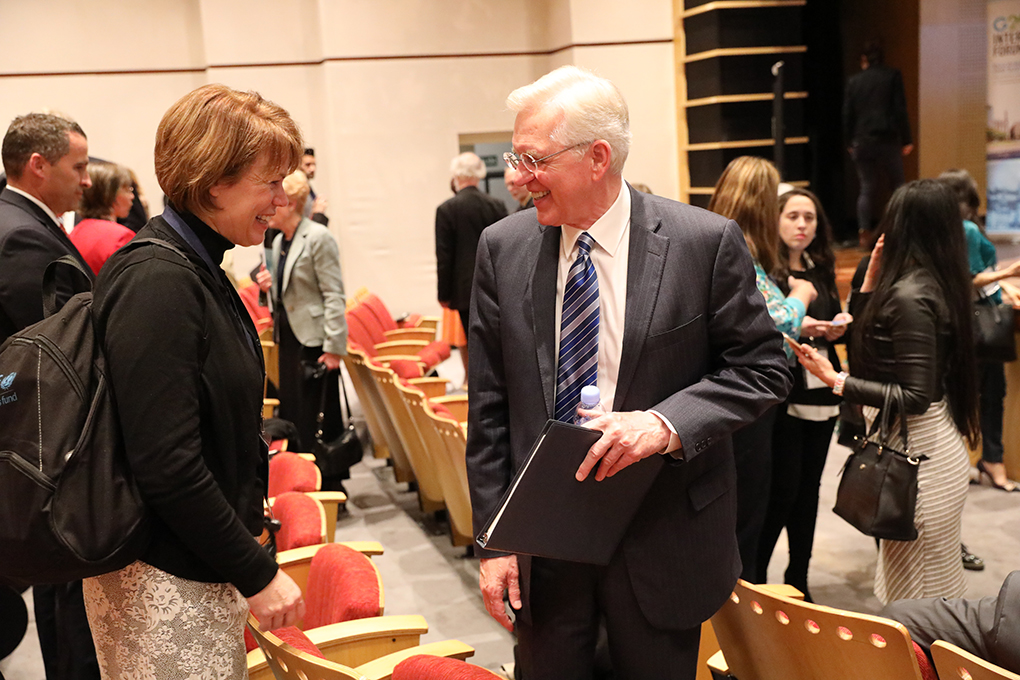 Sister Sharon Eubank and Elder D. Todd Christofferson converse on Sept. 27, 2018, at the G20 Interfaith Forum in Buenos Aires, Argentina. Both addressed faith leaders gathered for the global event.