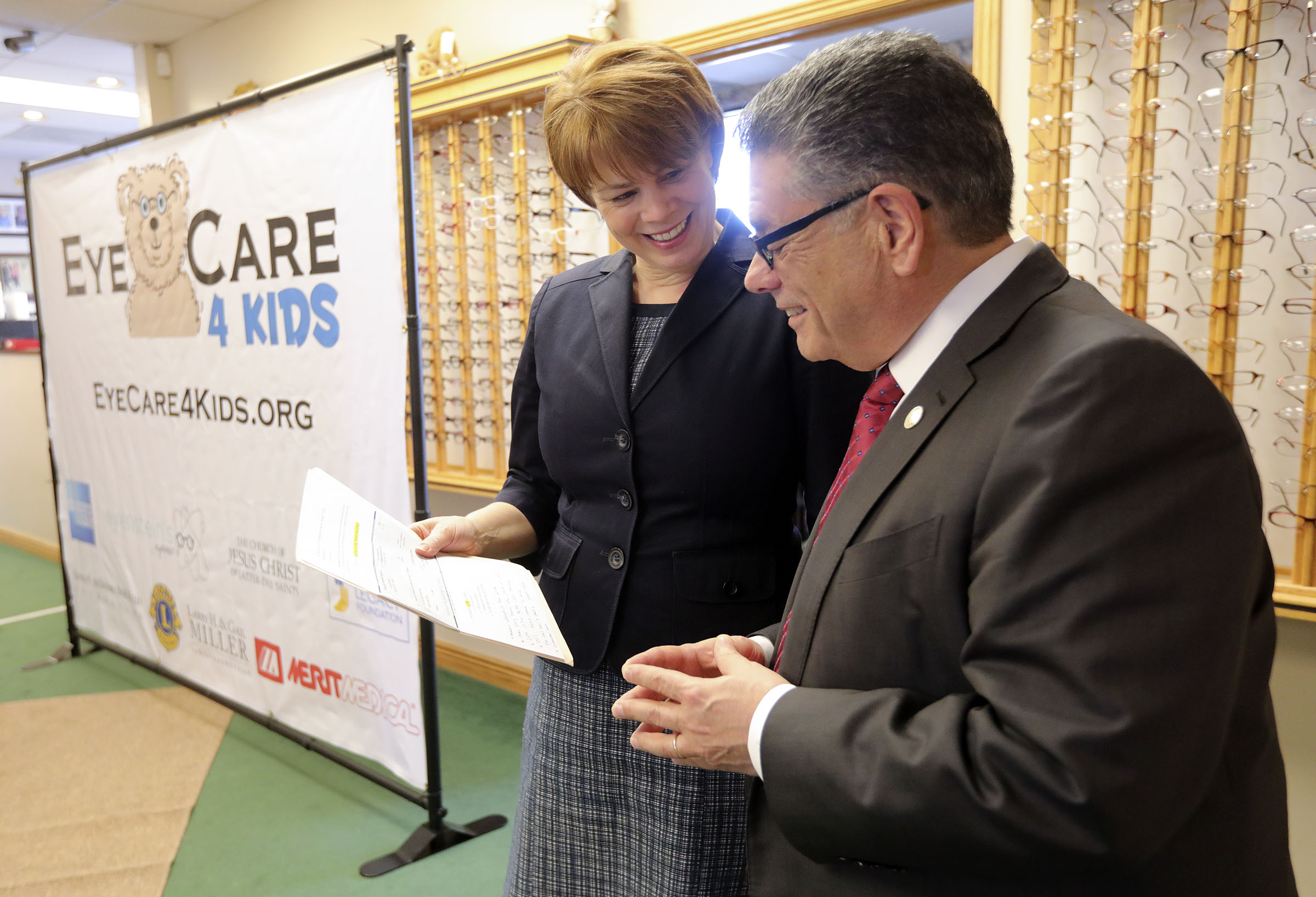 Sister Sharon Eubank, first counselor in the Relief Society general presidency of The Church of Jesus Christ of Latter-day Saints, delivers a donation check for more than $93,000 from the church's 2018 Light the World campaign to Joseph Carbone, right, president and founder of Eye Care 4 Kids, at Eye Care 4 Kids in Midvale, Utah, on Thursday, Feb. 7, 2019.
