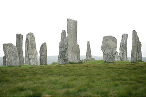 Callanish I, tall, silvery Lewisian gneiss stones positioned in circle and in rows and dating back to 1800 B.C., stand near town of Stornoway.
