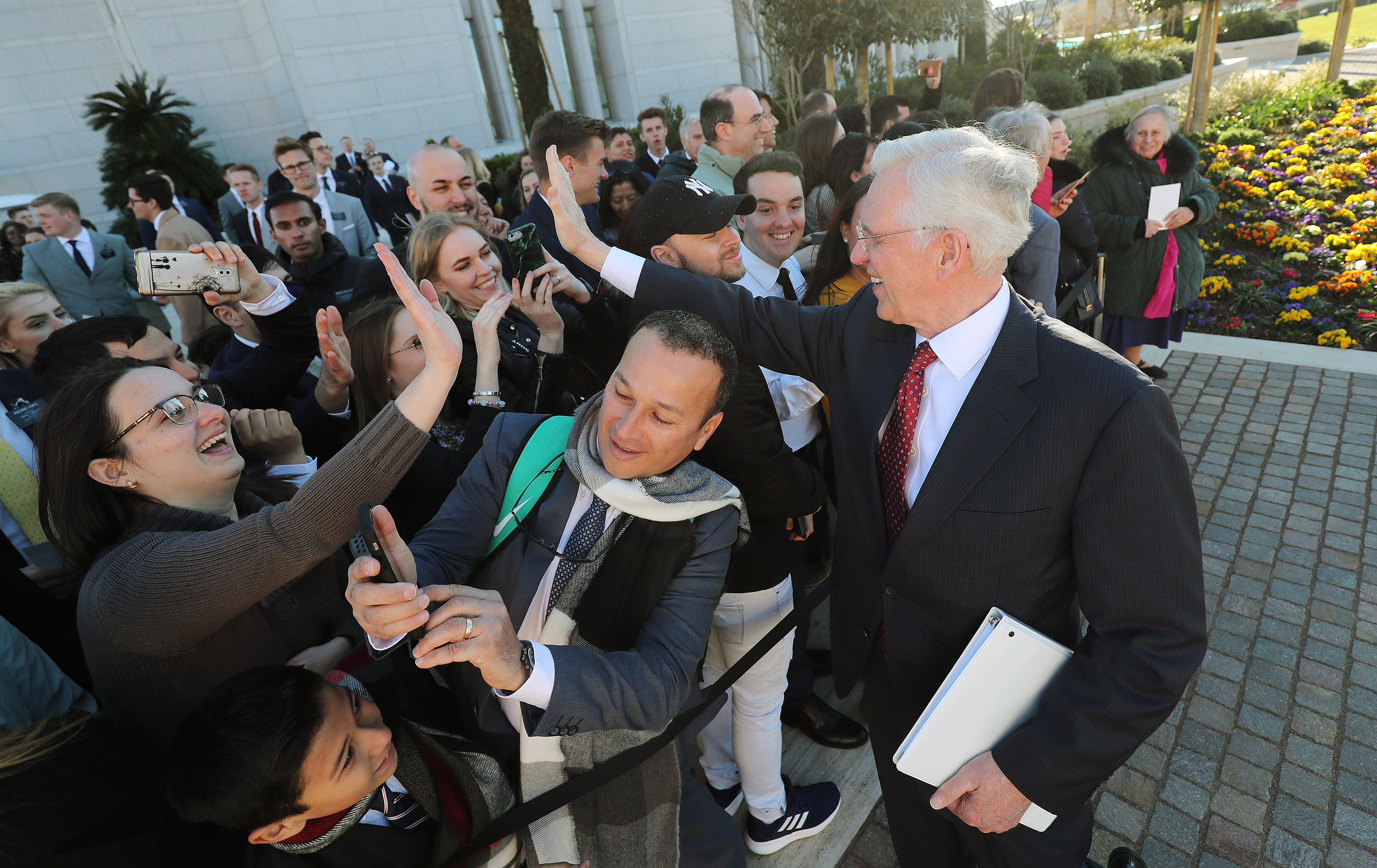 Elder D. Todd Christofferson, of the Quorum of the Twelve Apostles of The Church of Jesus Christ of Latter-day Saints, high-fives temple attendees in Rome, Italy, on Tuesday, March 12, 2019.