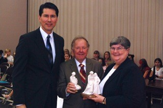 President Jon Dionne, left, first counselor in the Centreville stake presidency, looks on as Virginia State Senator Charles Colgan presents the 2011 Family Values Award Cecilia Dwyer, prioress of St. Benedict Monastery in Bristow, Virginia.