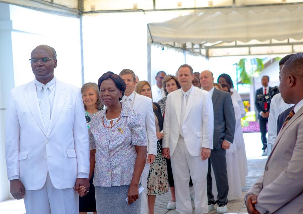 Elder Joseph W. Sitati, first counselor in the Africa Southeast Area Presidency, with his wife, Sister Gladys Sitati, participate in the cornerstone ceremony of the Kinshasa DR Congo Temple on Sunday, April 14, 2019. Africa Southeast Area president Elder S. Mark Palmer and his wife, Sister Jacqueline Palmer, and Elder Joni L. Koch, second counselor, with his wife, Sister Michele Koch, are behind the Sitatis.
