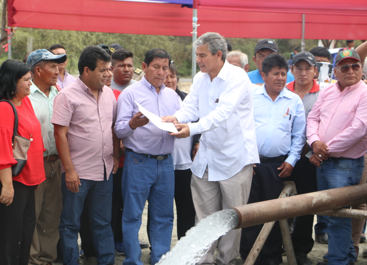 Piura (Peru) Regional Governor Reynaldo Hilbck Guzman, center, dedicates the Church-sponsored well in San Cristo, Peru, on Nov. 23, 2018. The well will provide clean water to thousands of local residents and is expected to be a boon to the health of the region.