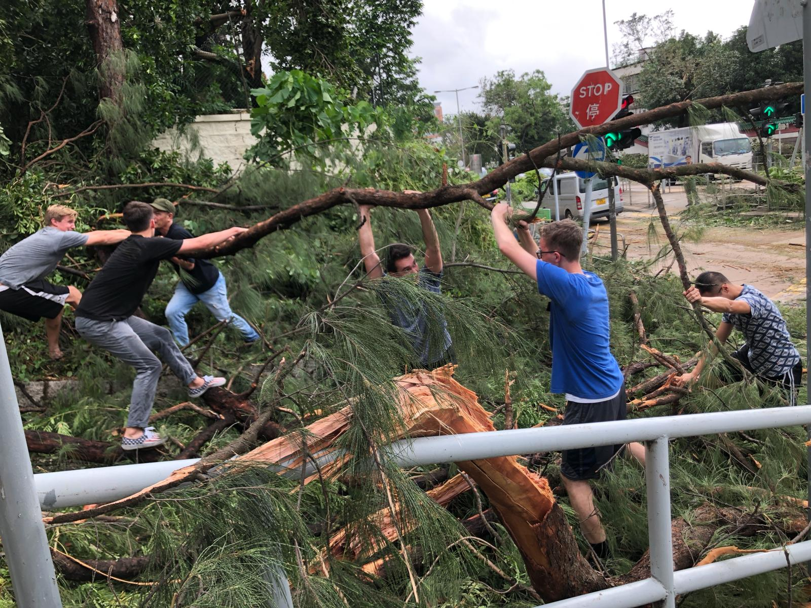 Latter-day Saint missionaries clean up debris in Hong Kong after Super Typhoon Mangkhut his Asia, September 17, 2018.