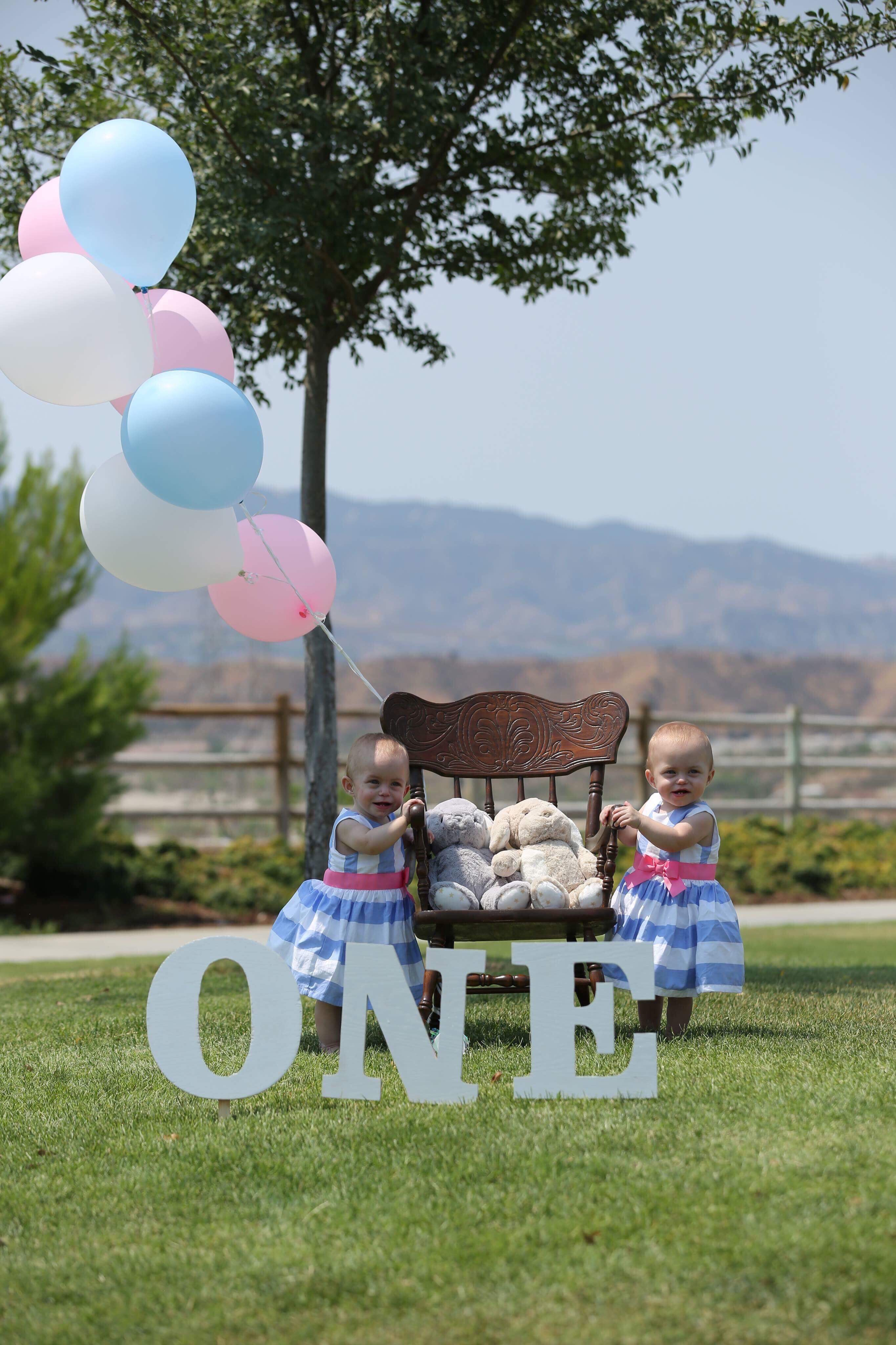 Sarah and Hannah Evans celebrating their first birthday. They were born prematurely and spent the first few months of their lives at the UCLA hospital.