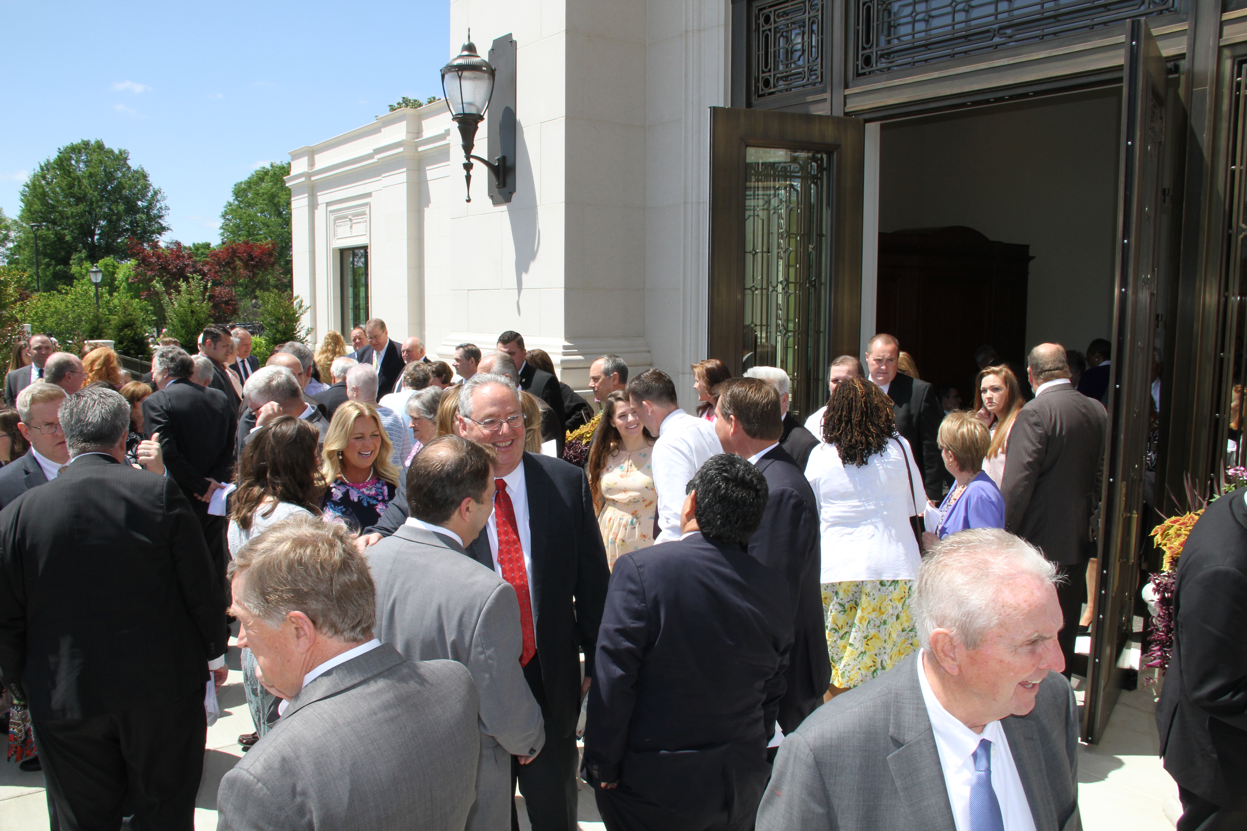 Attendees of the Memphis Tennessee Temple rededication exit the temple after the ceremony on May 5, 2019.