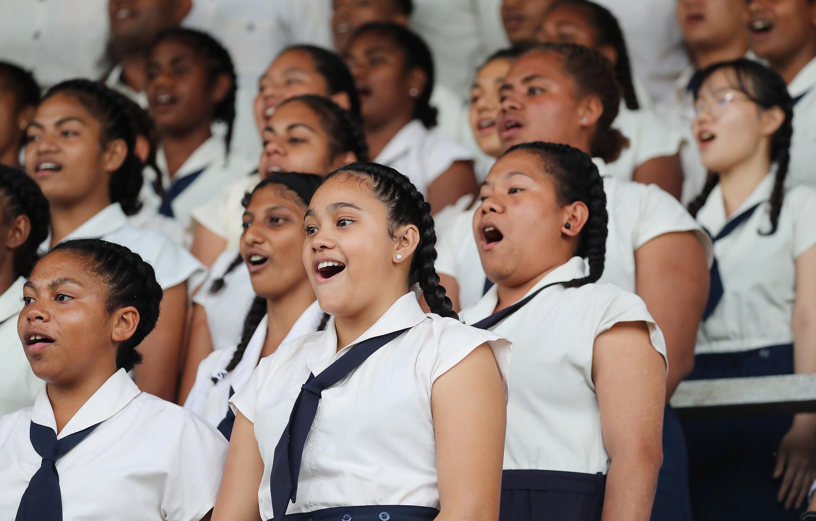 The choir sings during a devotional at Ratu Cakobau stadium in Nausori, Fiji on May 22, 2019.