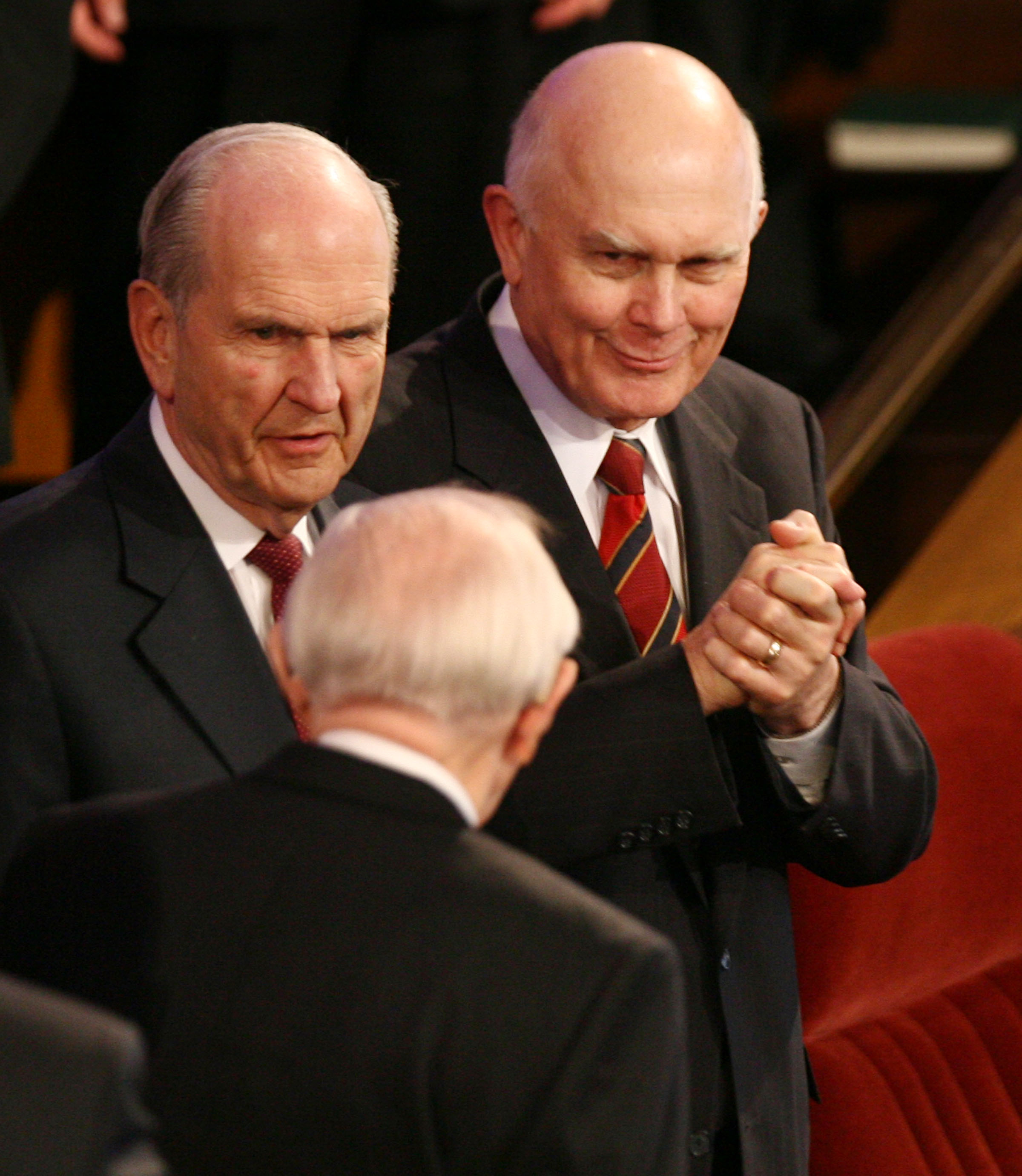 Elder Dallin H. Oaks (right) gestures to President Gordon B. Hinckley as President Hinckley passes him and Elder Russell M. Nelson while leaving the Salt Lake Tabernacle on Temple Square following the afternoon session of The Church of Jesus Christ of Latter-day Saints' 177th Annual General Conference March 31, 2007.