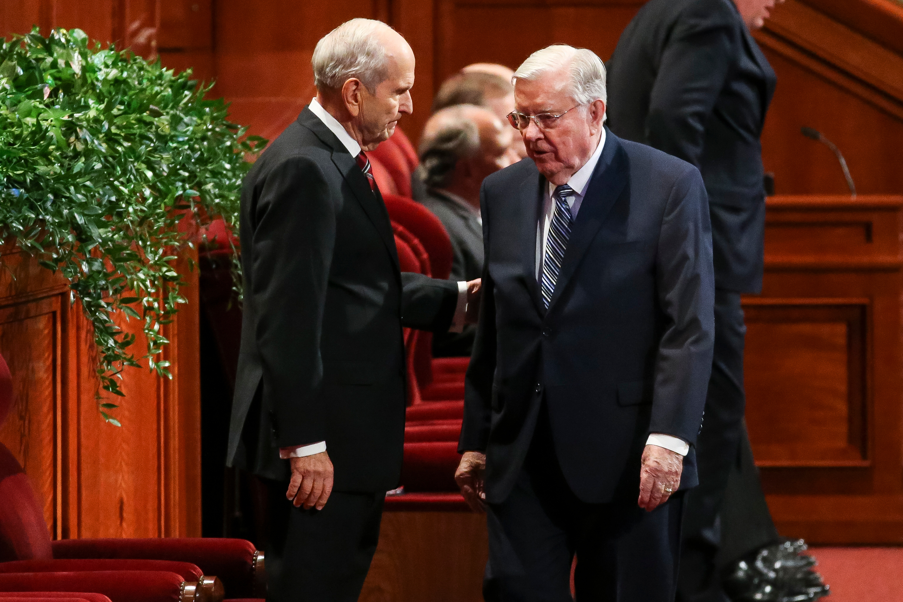 President Russell M. Nelson, left, and Elder M. Russell Ballard, both of the Quorum of the Twelve Apostles, greet each other at the start of the Saturday afternoon session of the Church's 187th Semiannual General Conference in Salt Lake City on Saturday, Sept. 30, 2017.