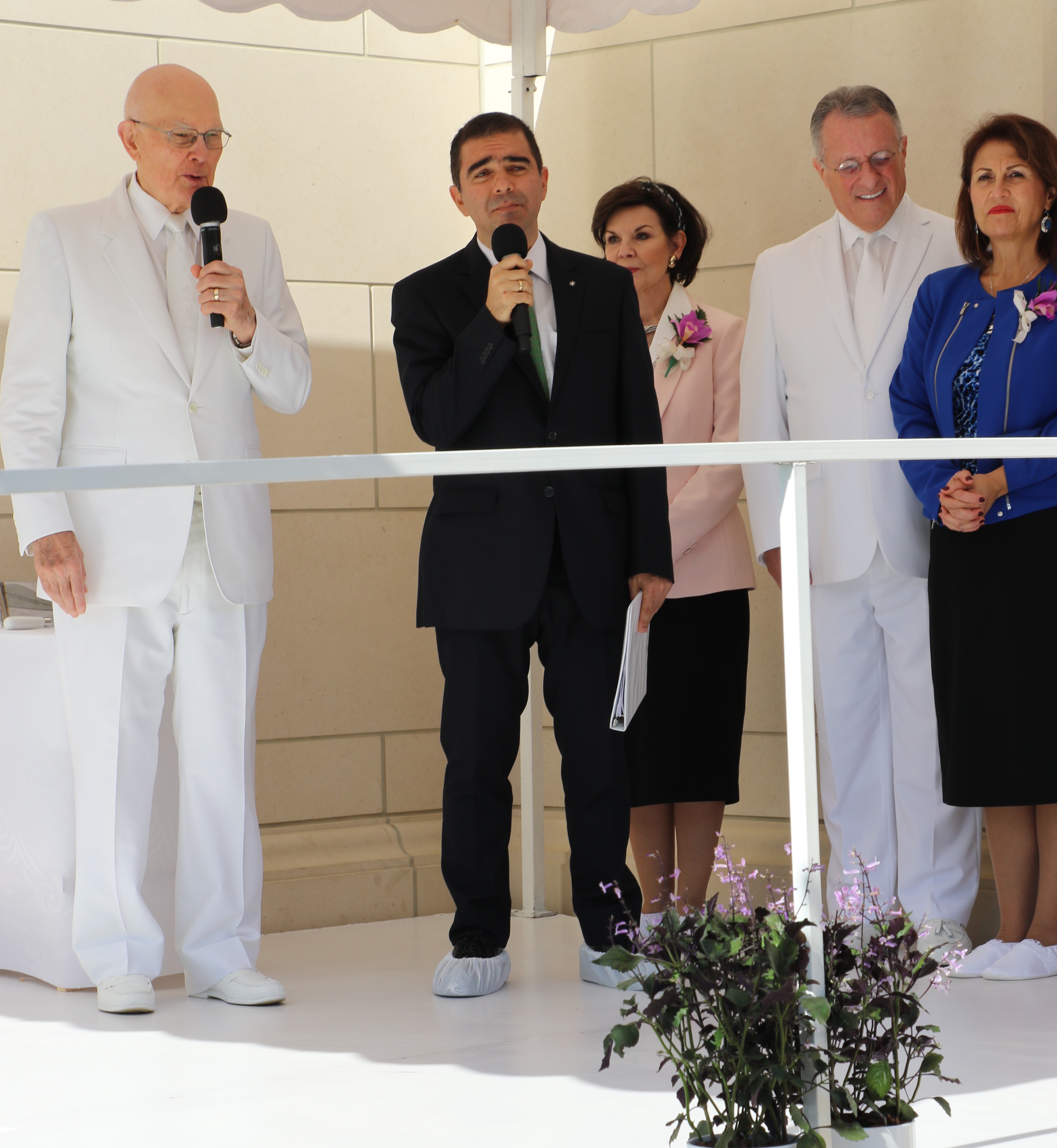 President Dallin H. Oaks, left, welcomes visitors to the cornerstone ceremony of the Barranquilla Colombia Temple on Sunday Dec. 9, 2018. Participating in addition to the interpreter at the side of the first counselor in the First Presidency are Sister Kristen Oaks, center, Elder Ulisses Soares of the Quorum of the Twelve Apostles and Sister Rosana Soares.