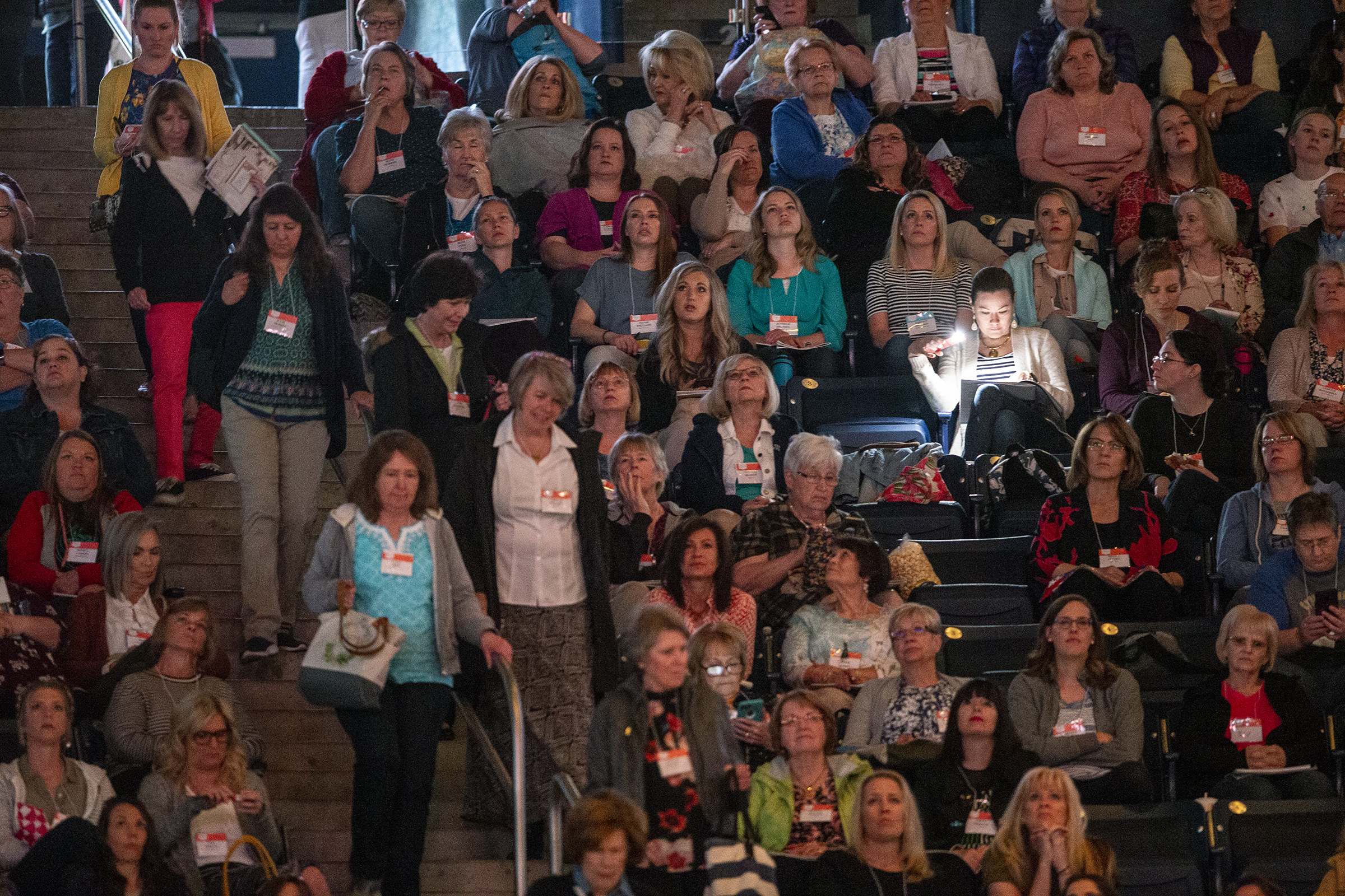 "Women find their seats as they take part in a ""Sister to Sister"" event during Women's Conference at BYU's Marriott Center in Provo, Utah, on Friday, May 3, 2019."
