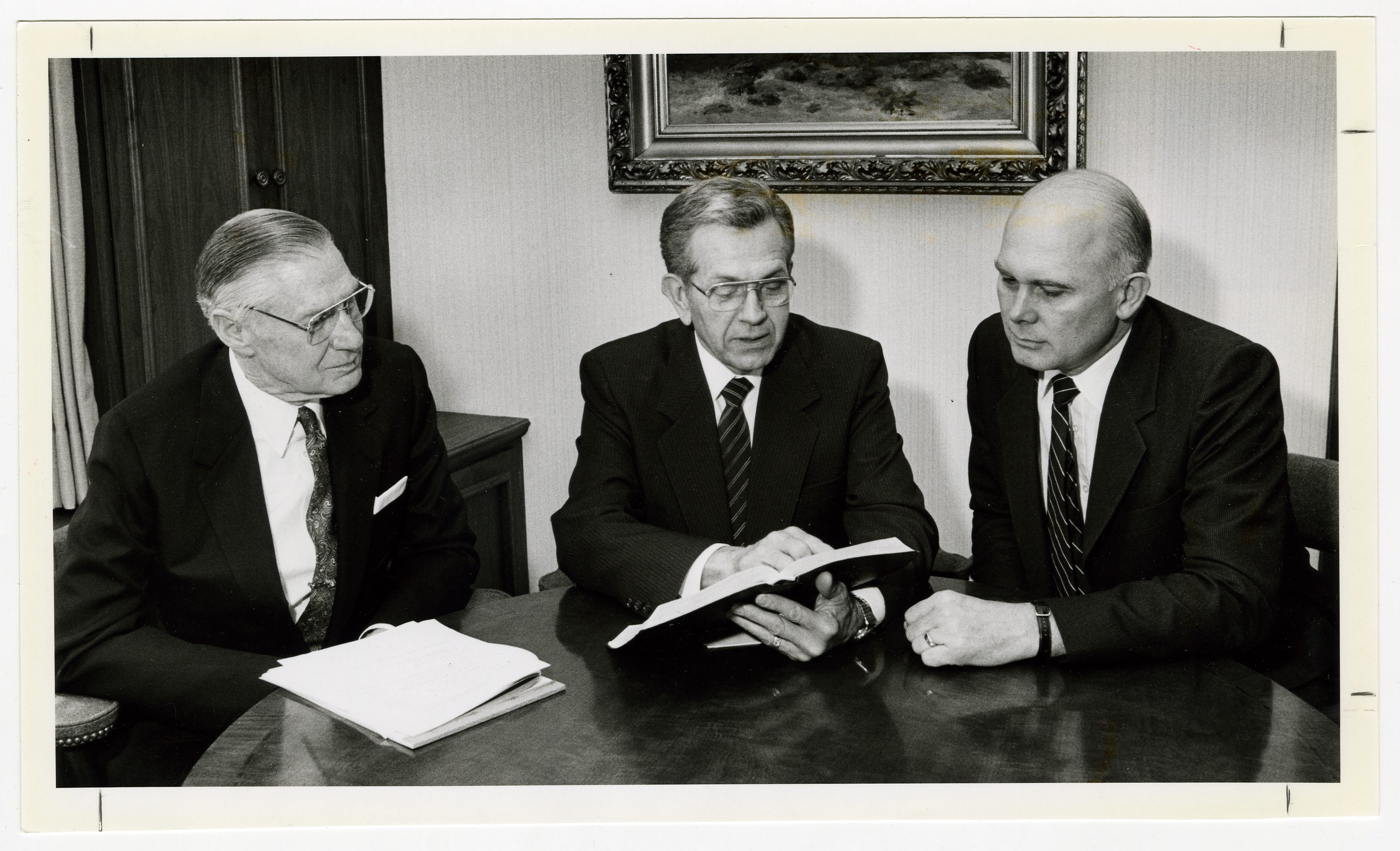 Elders Boyd K. Packer, center, James E. Faust and Dallin H. Oaks serve on temple and genealogy executive council June 6, 1987.